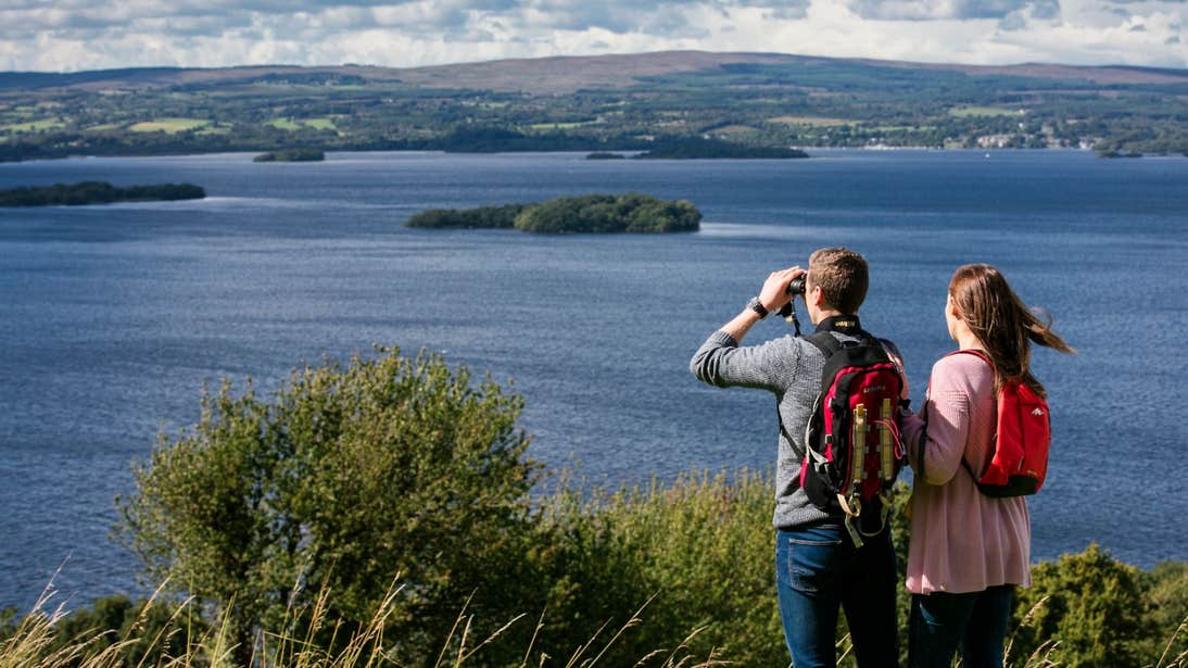 A man and a woman admiring the stunning views of Lough Derg