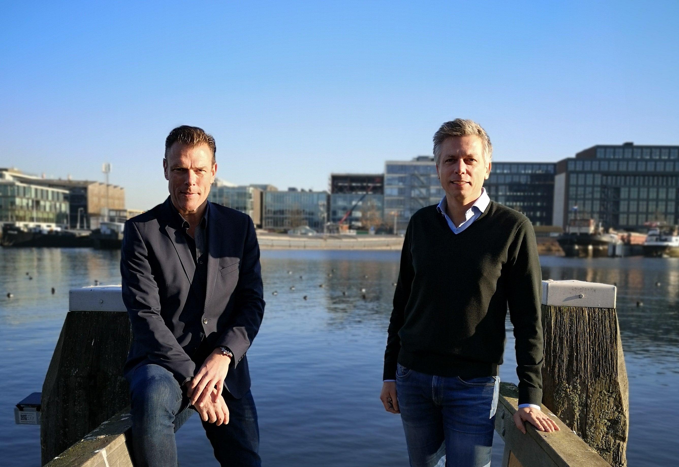 Julius Minnaar and  Mark van Dijk two men posing by the water