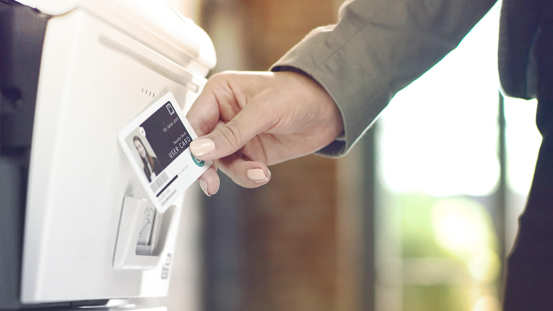 a card is hold in front of a printer for authentication