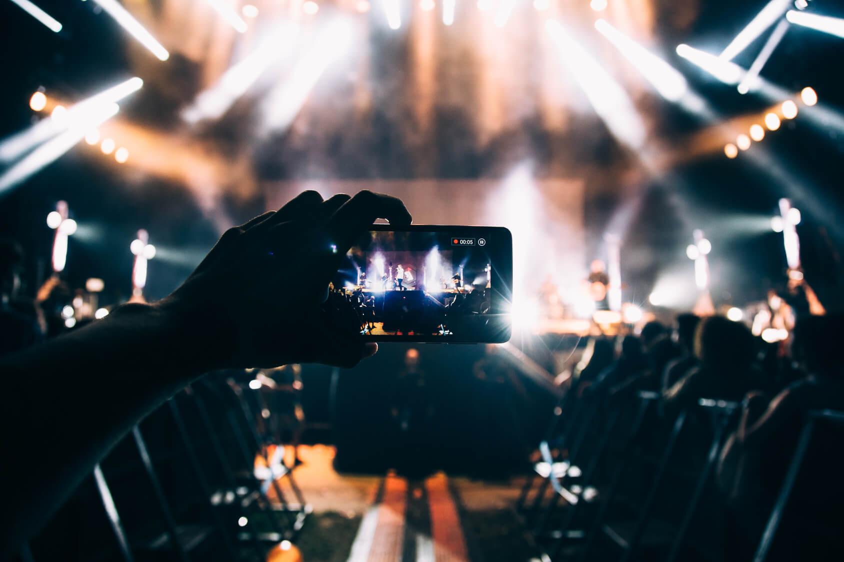 Concert being filmed through an iPhone