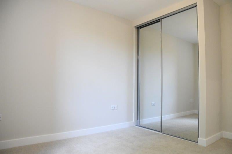 Image of bedroom with built in wardrobes at Steel Hill