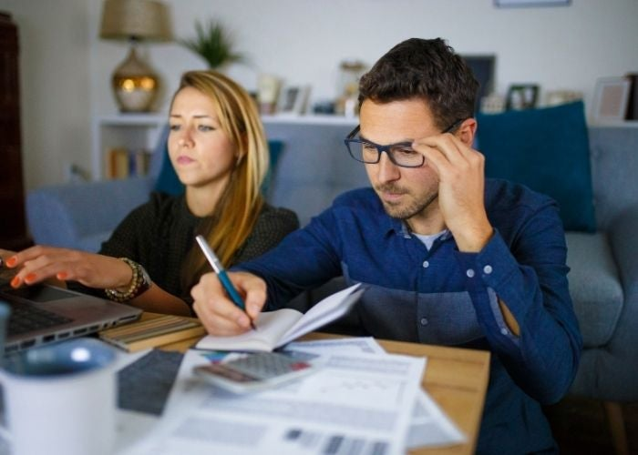 A couple working out the costs of buying their home