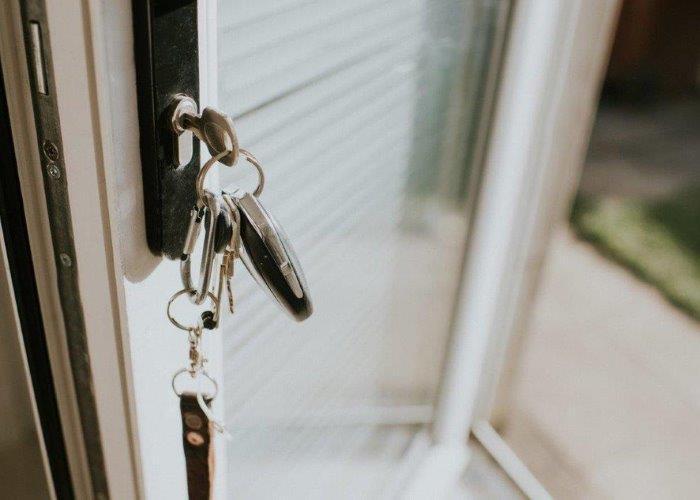 Image of keys in a glass door
