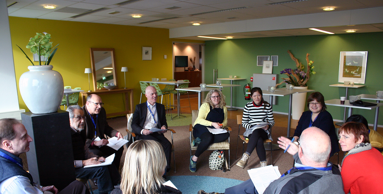 People sitting in a circle following an EPA course