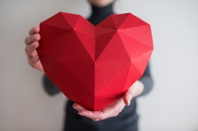 someone holding a heart-shaped object