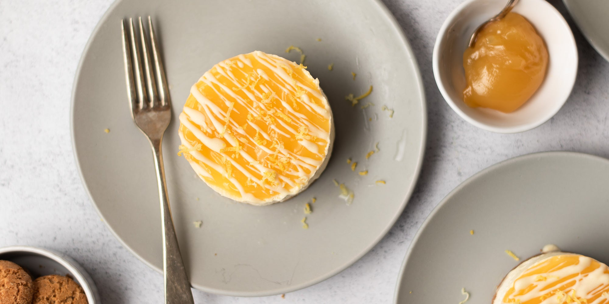 Mini Lemon Amaretti Cheesecake on a plate next to a fork