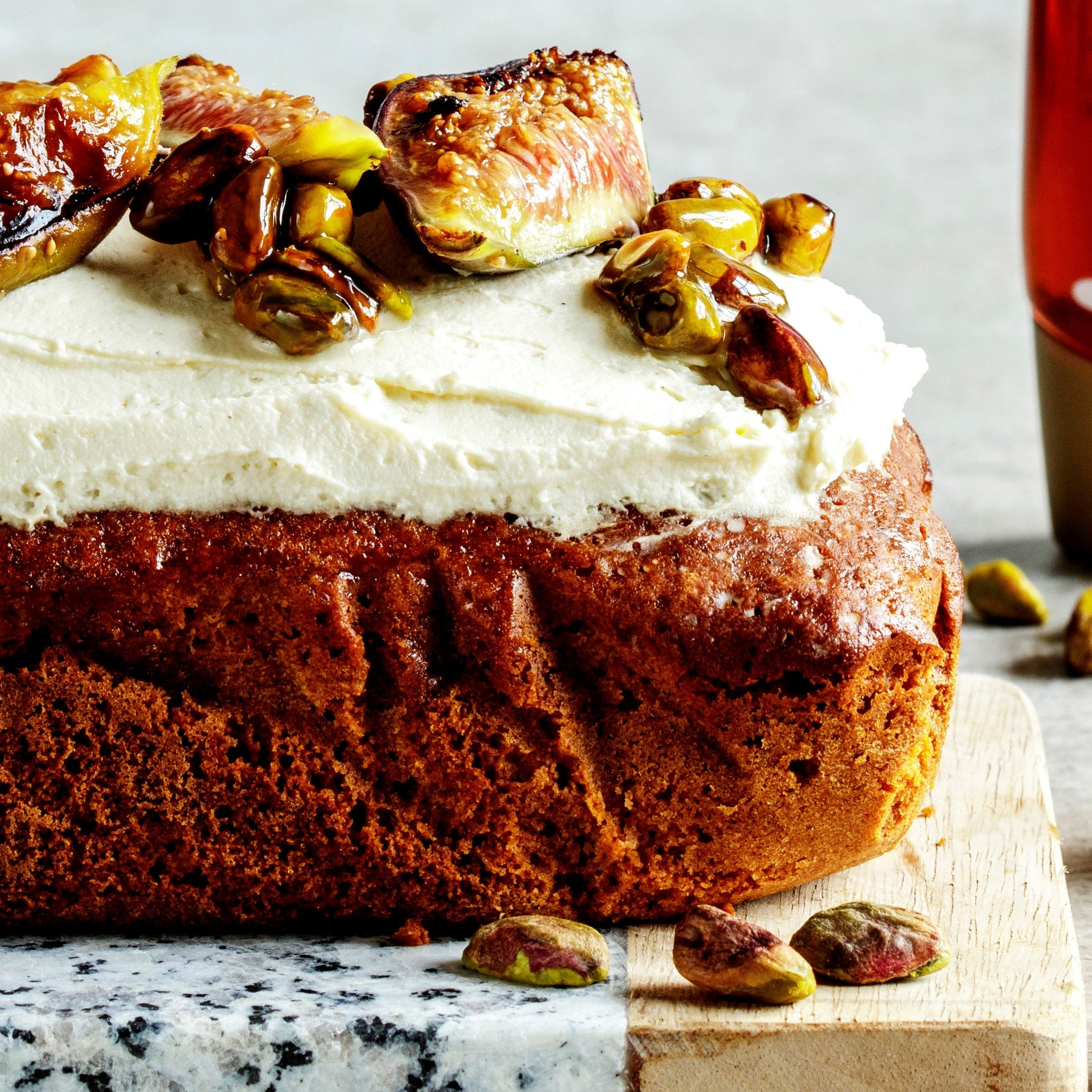 Close up of loaf cake with mascarpone topping and figs