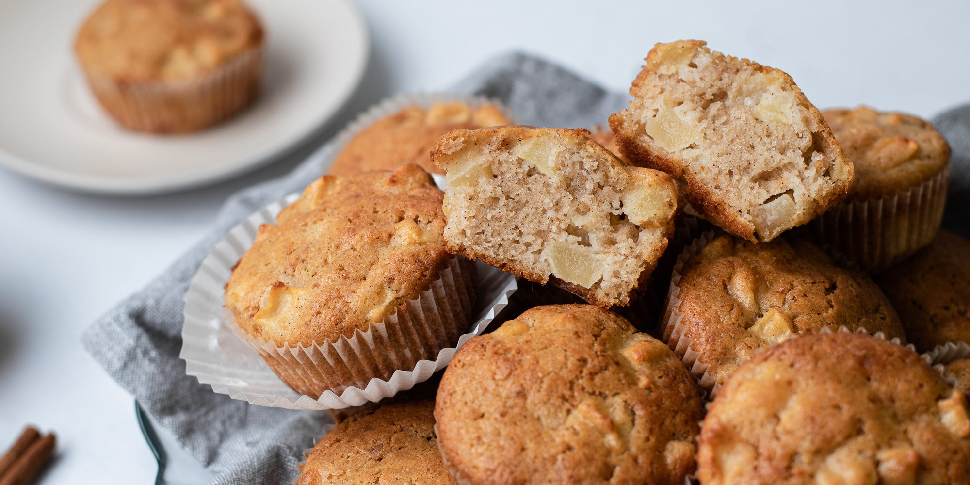 A stack of Calorie Conscious Apple & Cinnamon Muffins, cut open showing the inside of the bake