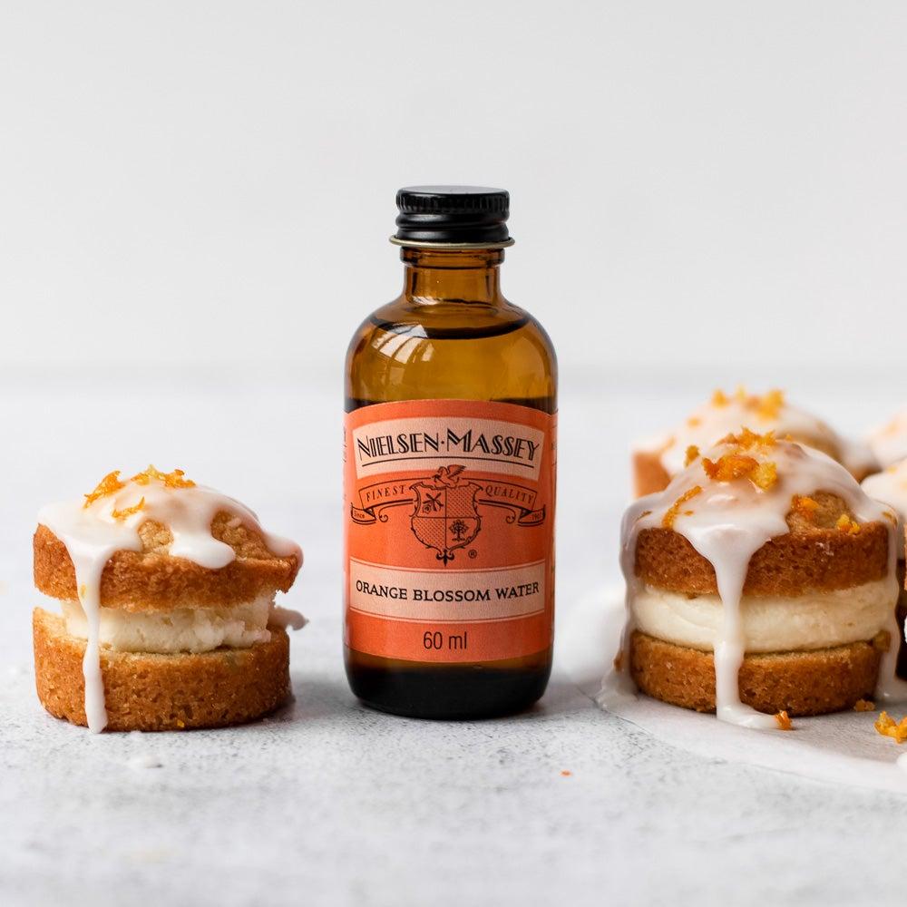 mini orange sponge cakes with glace icing on top
