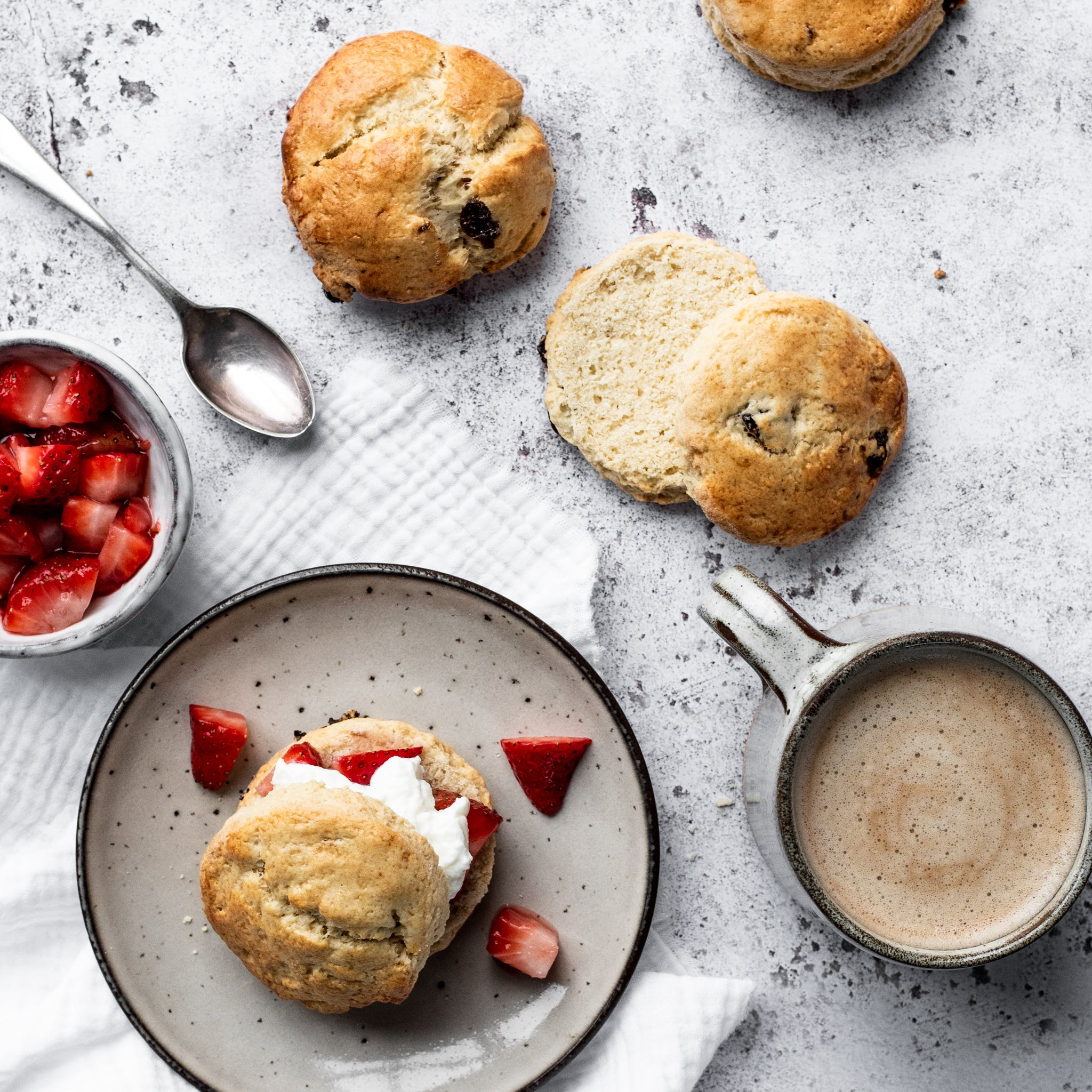 scone with strawberries and cream on a plate