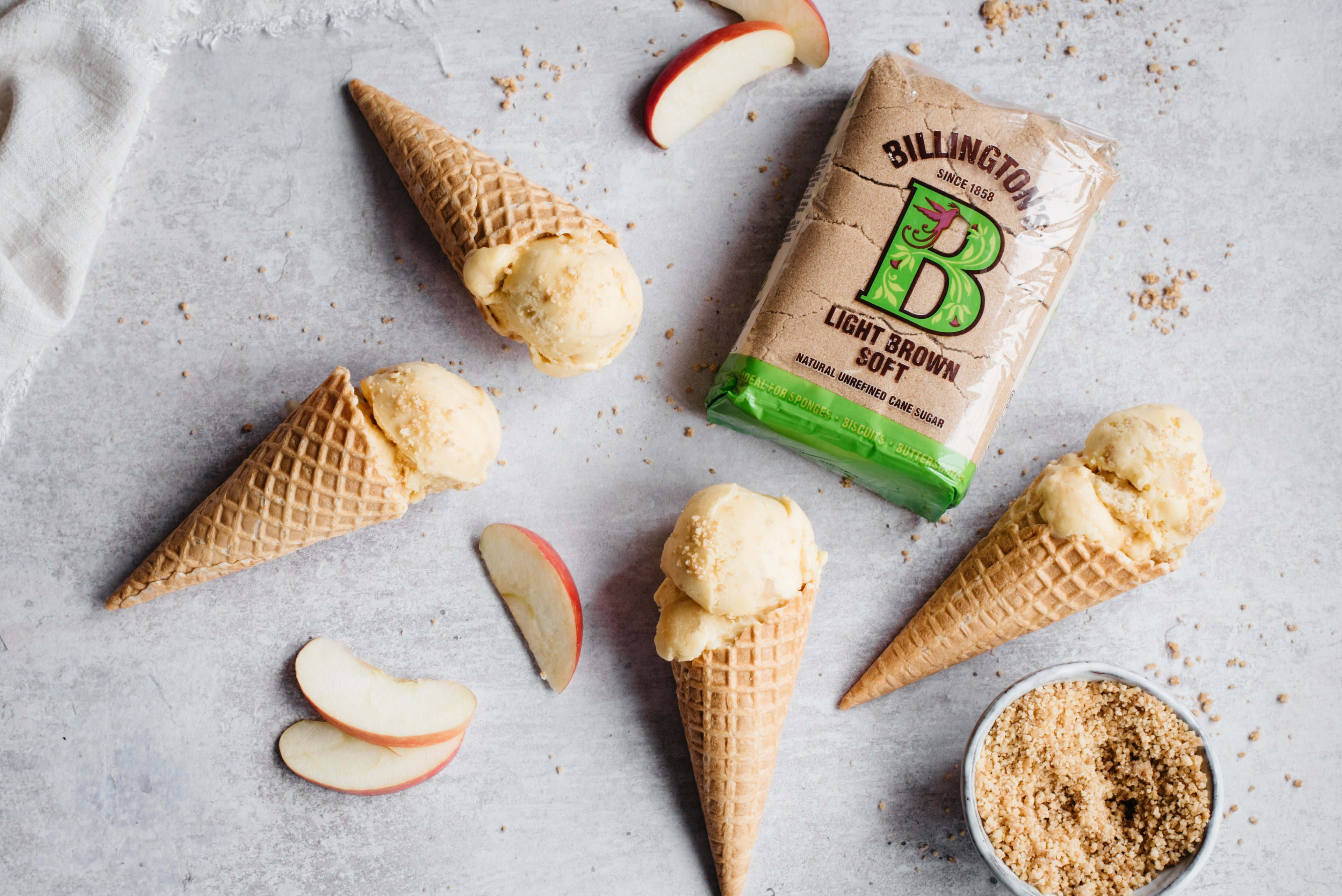 4 ice cream in cones with apple slices and brown sugar pack