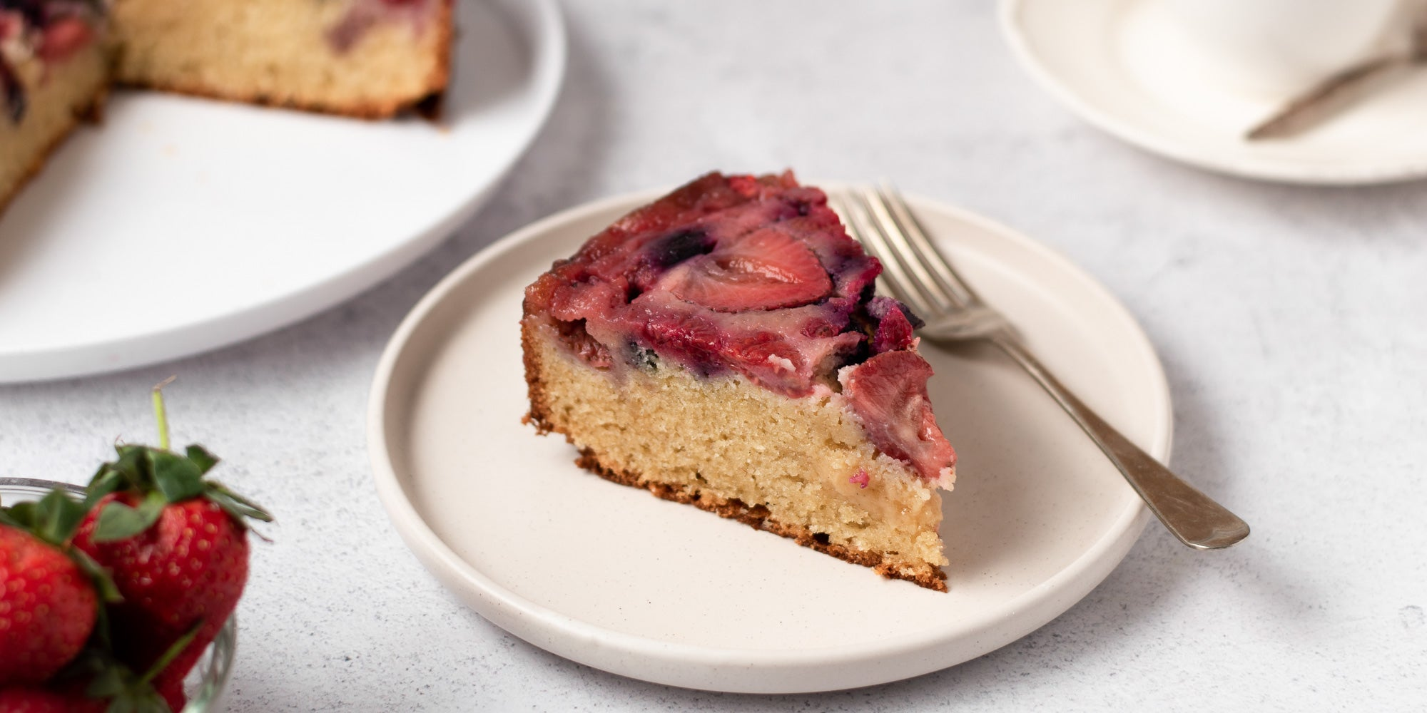 slice of upside down berry pudding on a plate