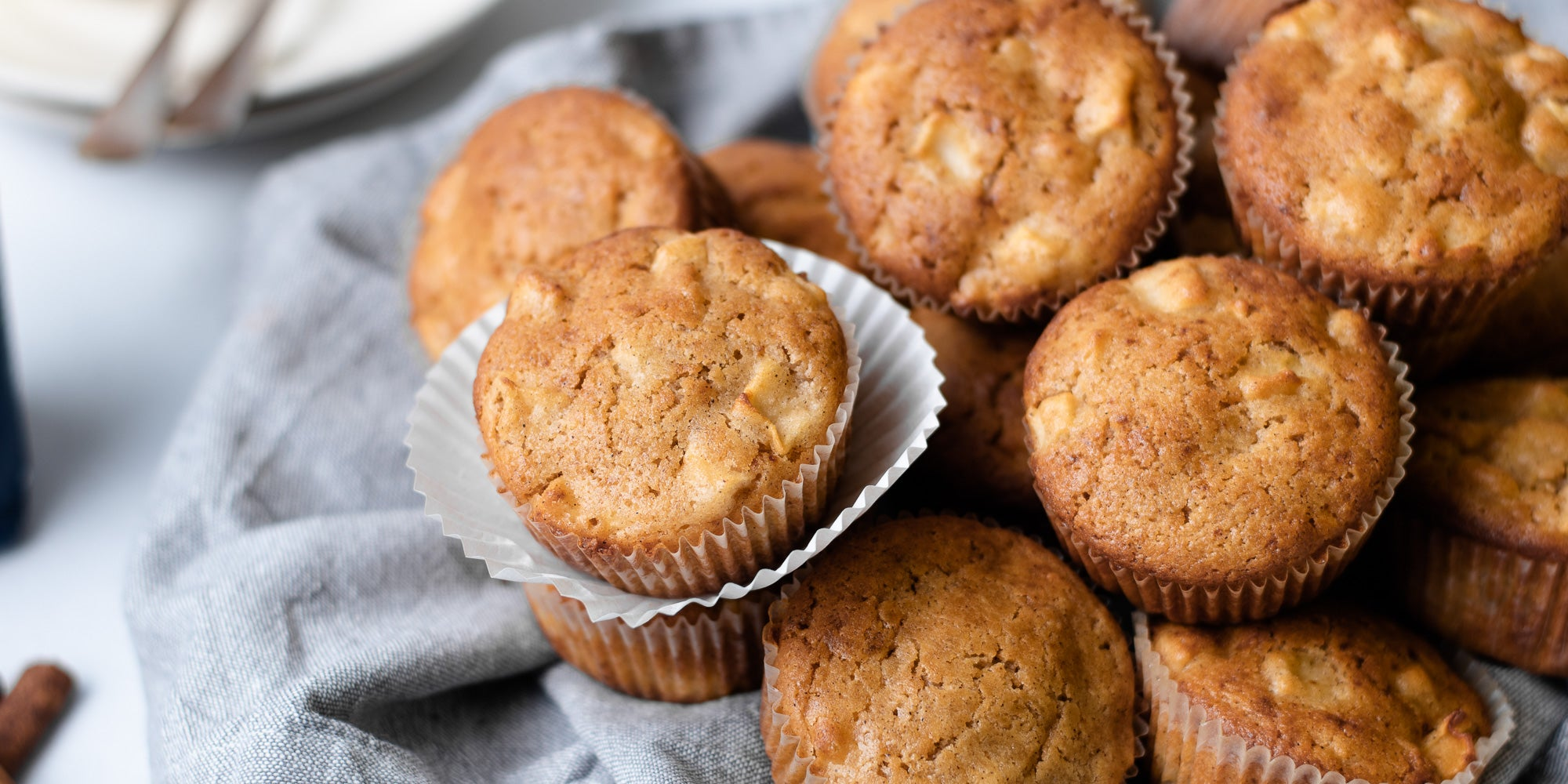Close up of Calorie Conscious Apple & Cinnamon Muffins on a grey cloth