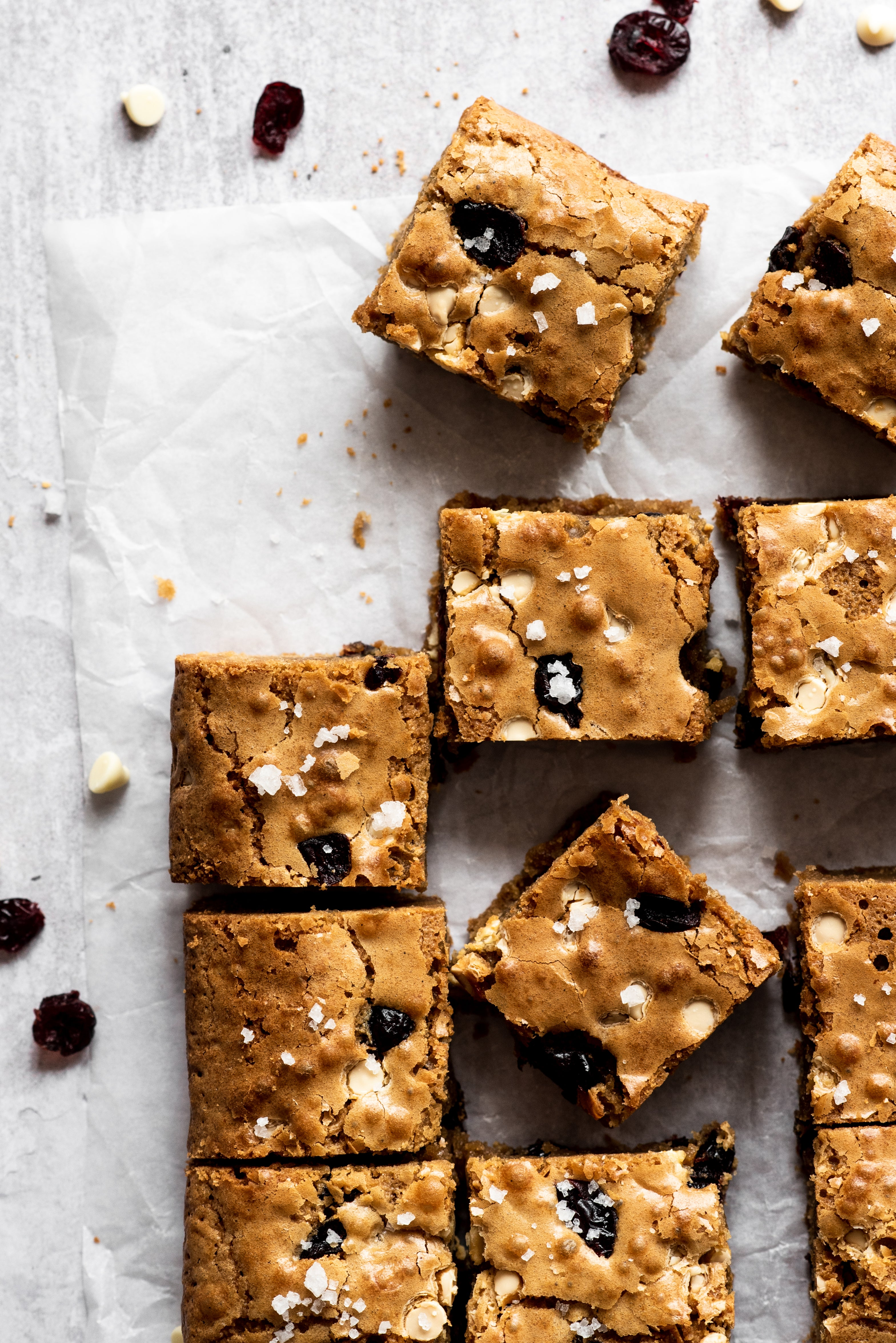 Blondies cut into squares laid on a surface