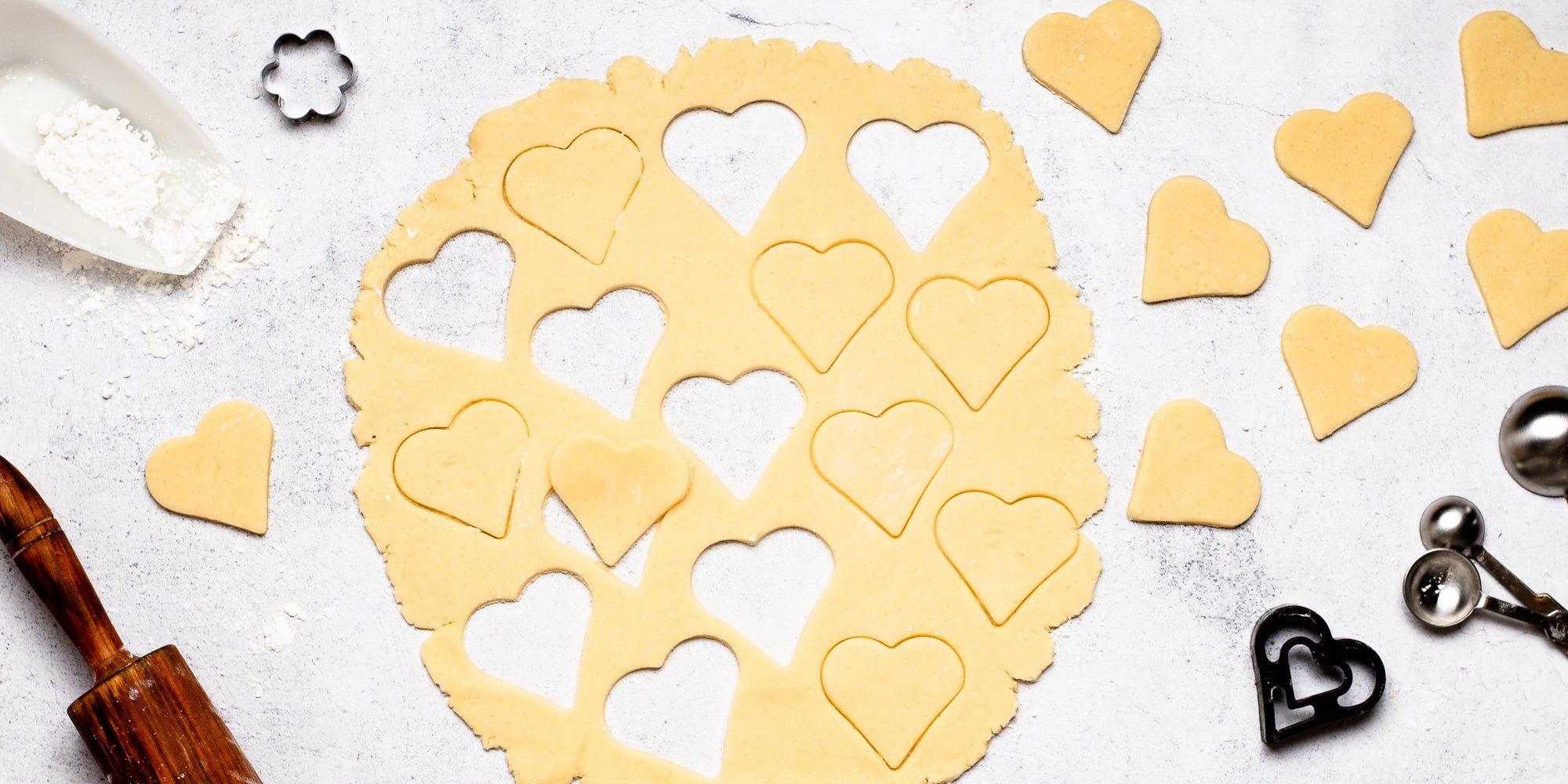 Top down view of hearts cut out in gluten free biscuit dough