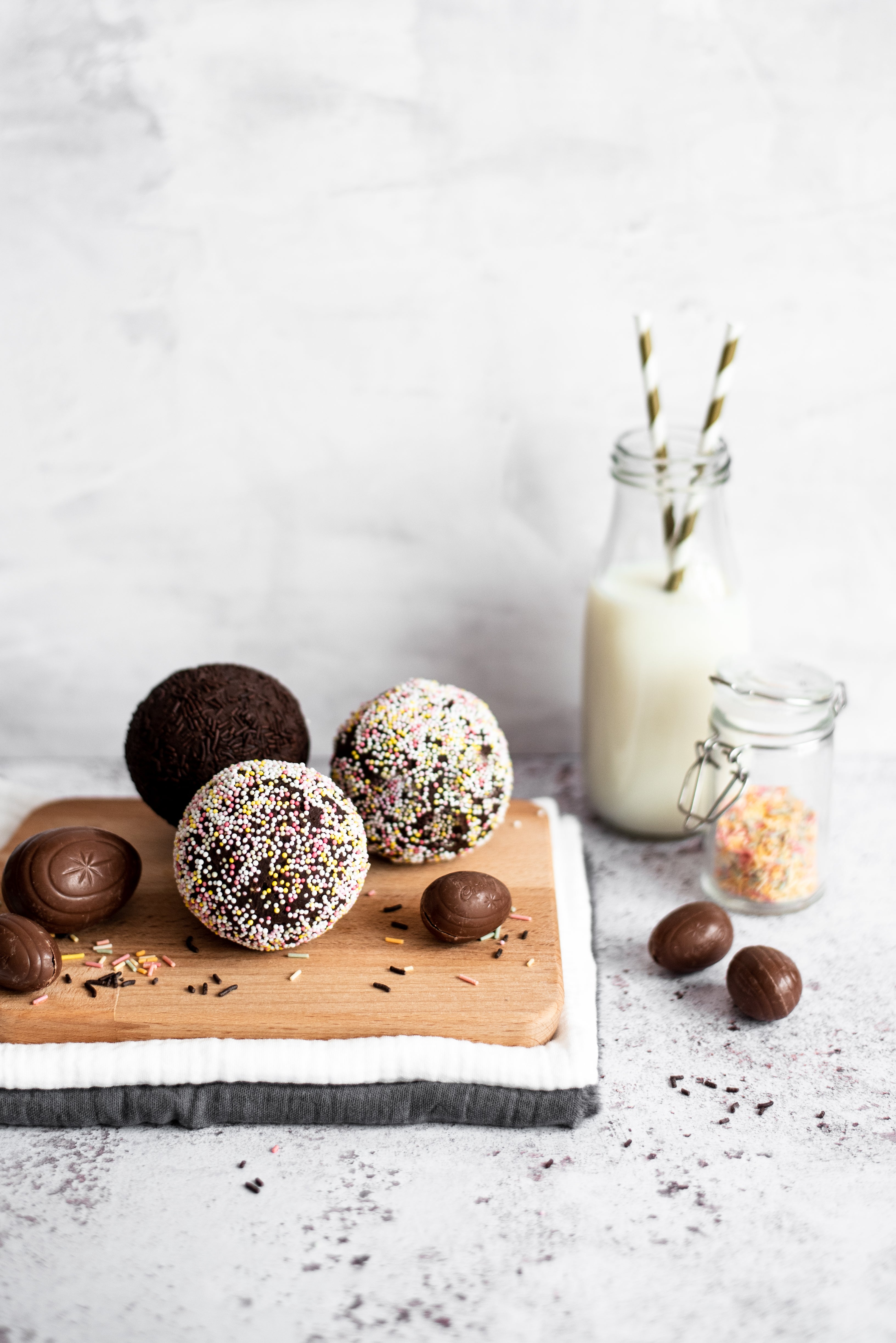 chocolate scotch eggs on a wooden board