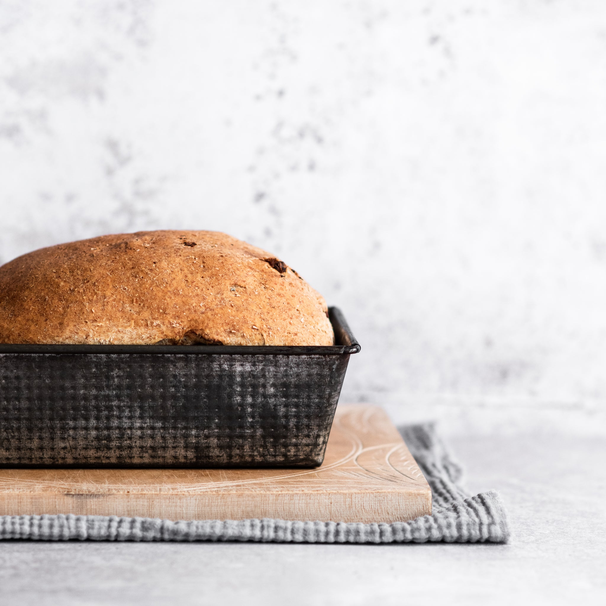 Loaf of bread in a baking tin