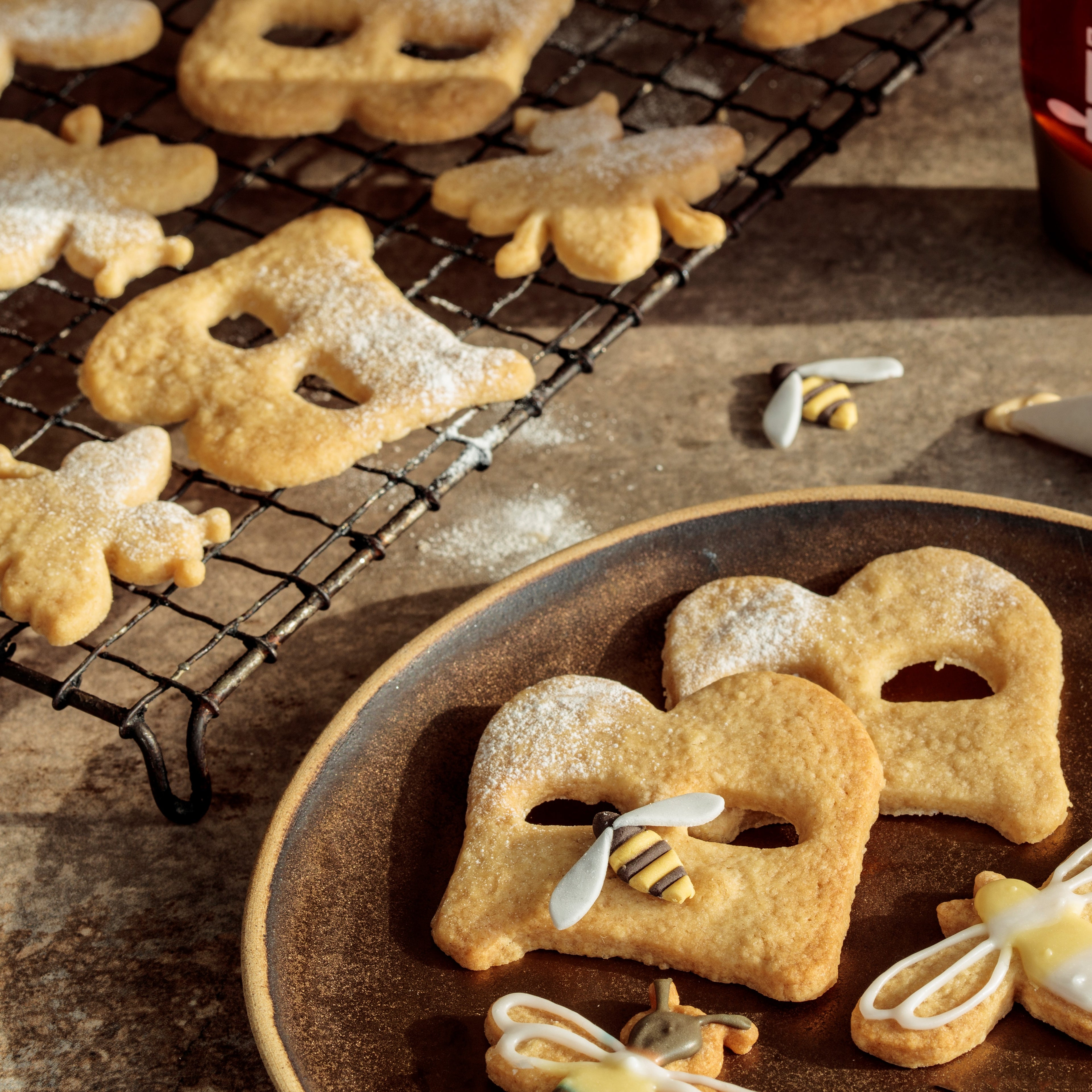 Biscuits in shape of letter B and bumble bees