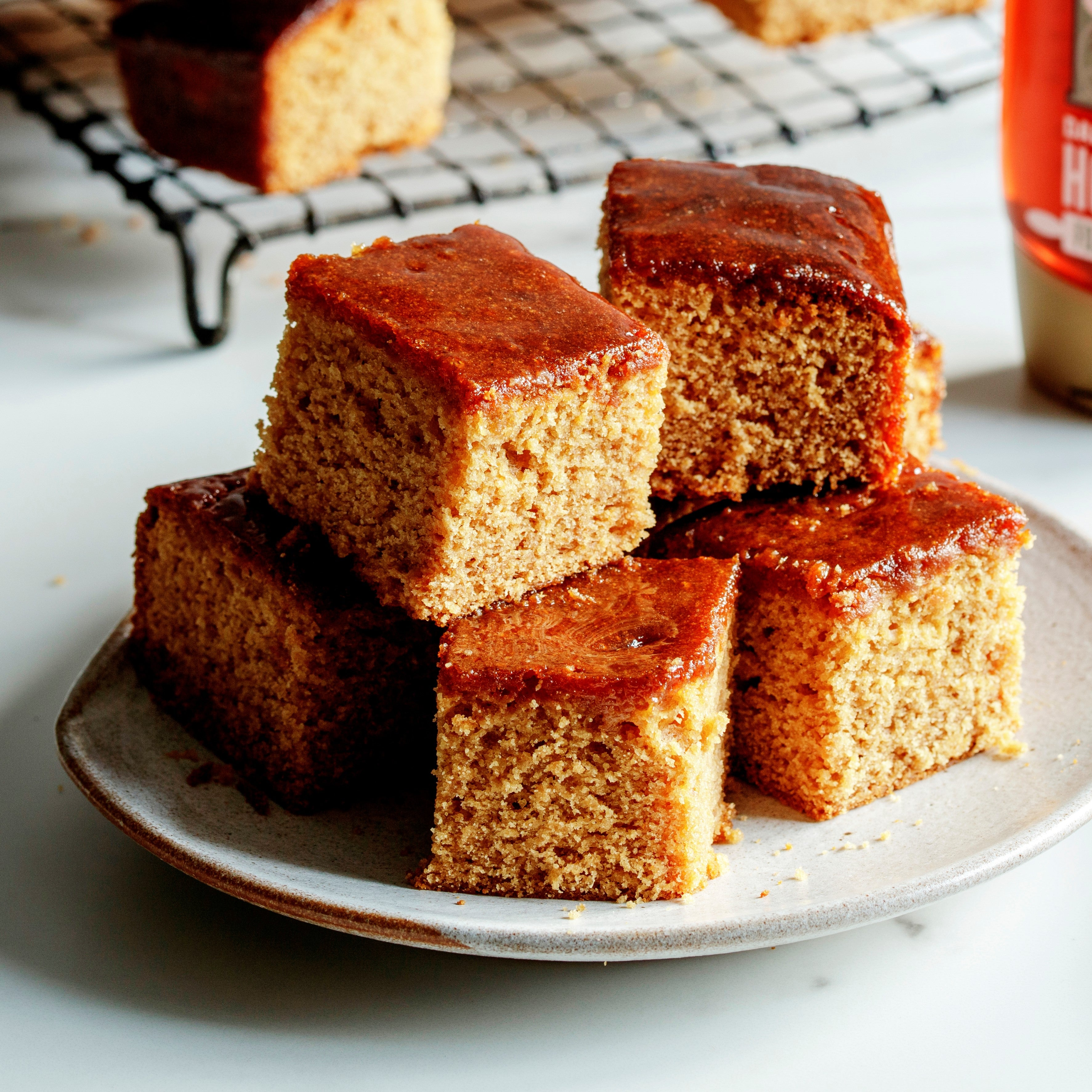 Squares of cake stacked on a plate