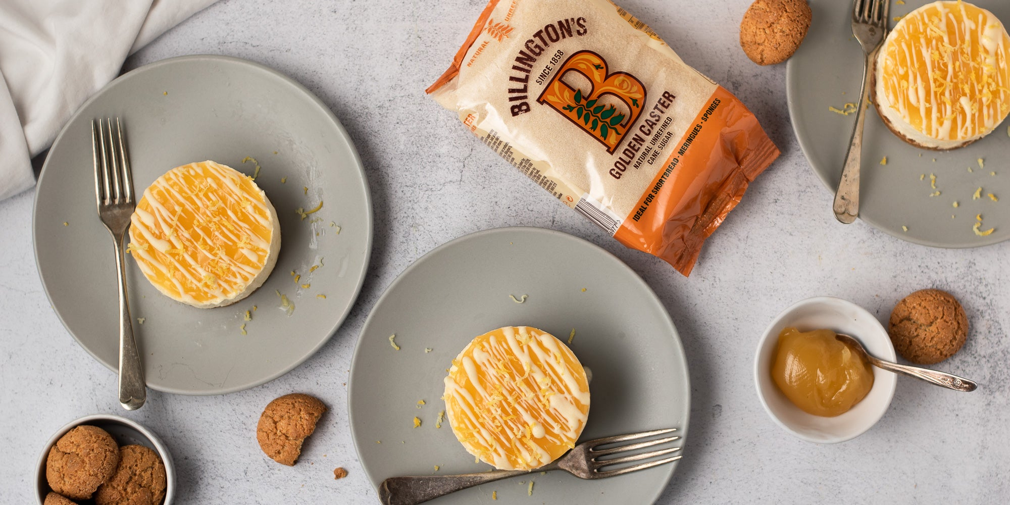 Three Mini Lemon Amaretti Cheesecakes on a plate