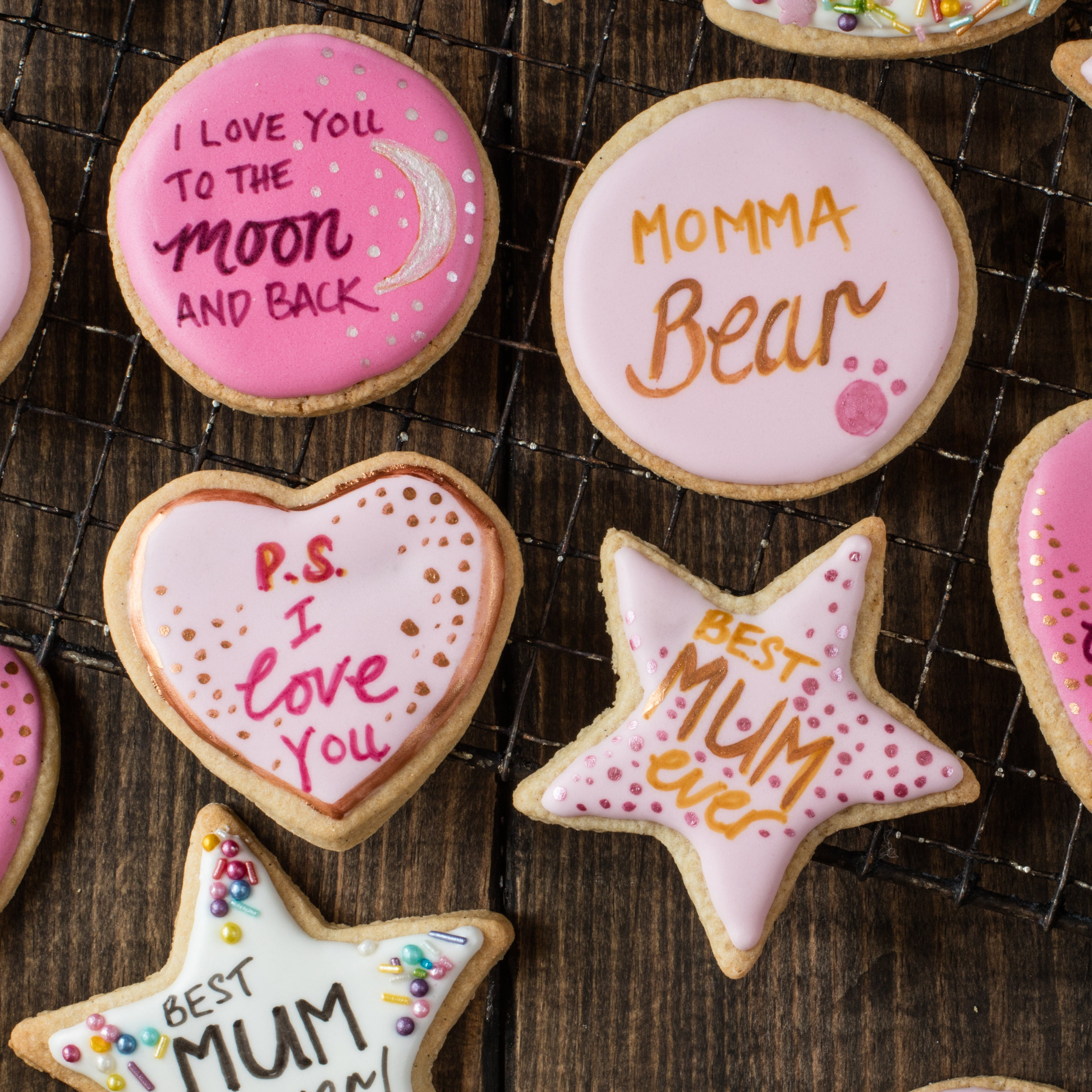 Close up of mothers day iced cookies with motivational writing on it