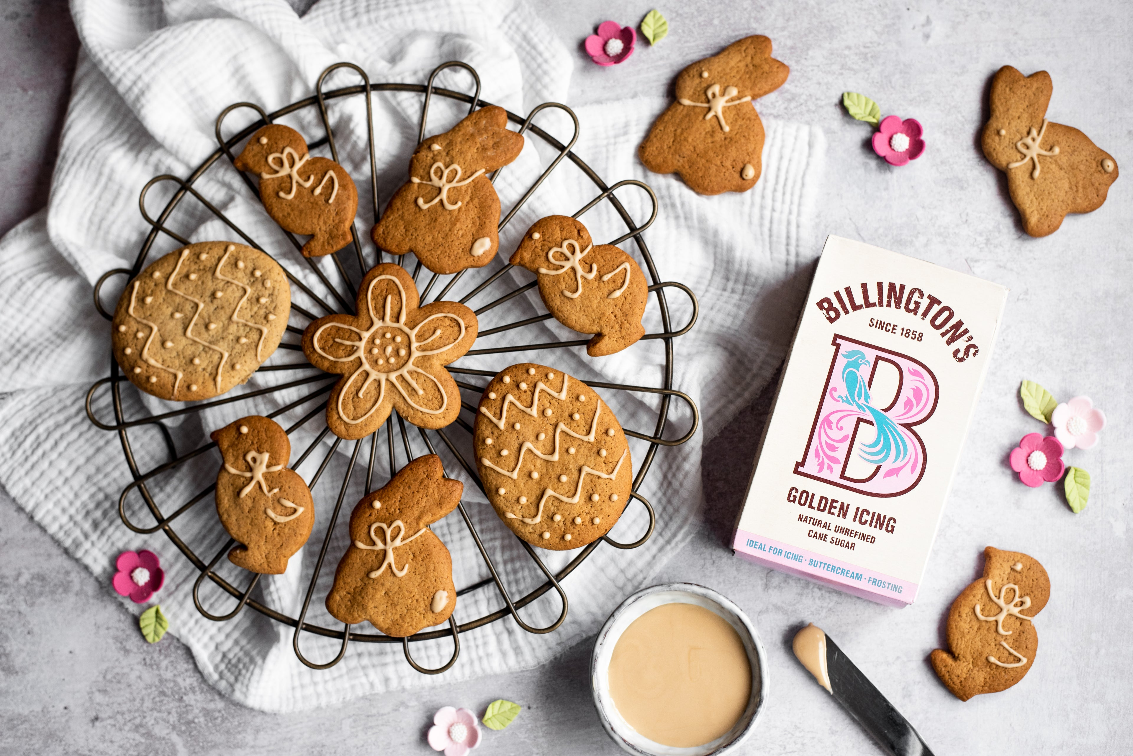 Easter shaped ginger biscuits on a cooling rack