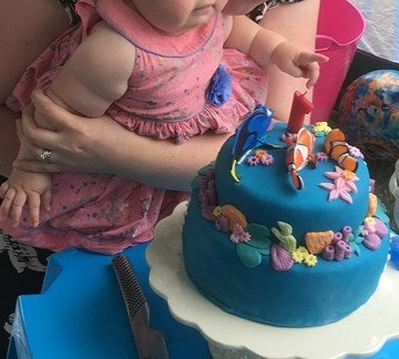 girl with blue birthday cake