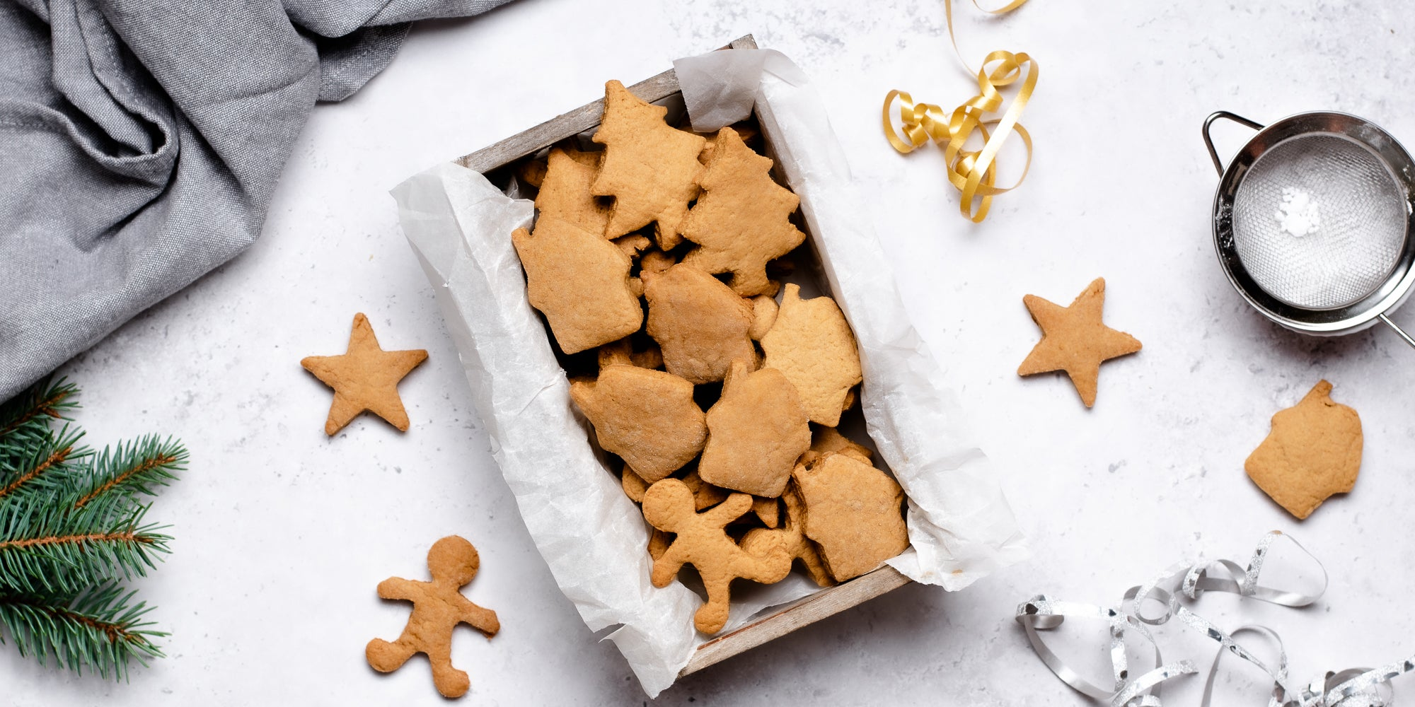 Top down view of vegan gingerbread men and stars in a box
