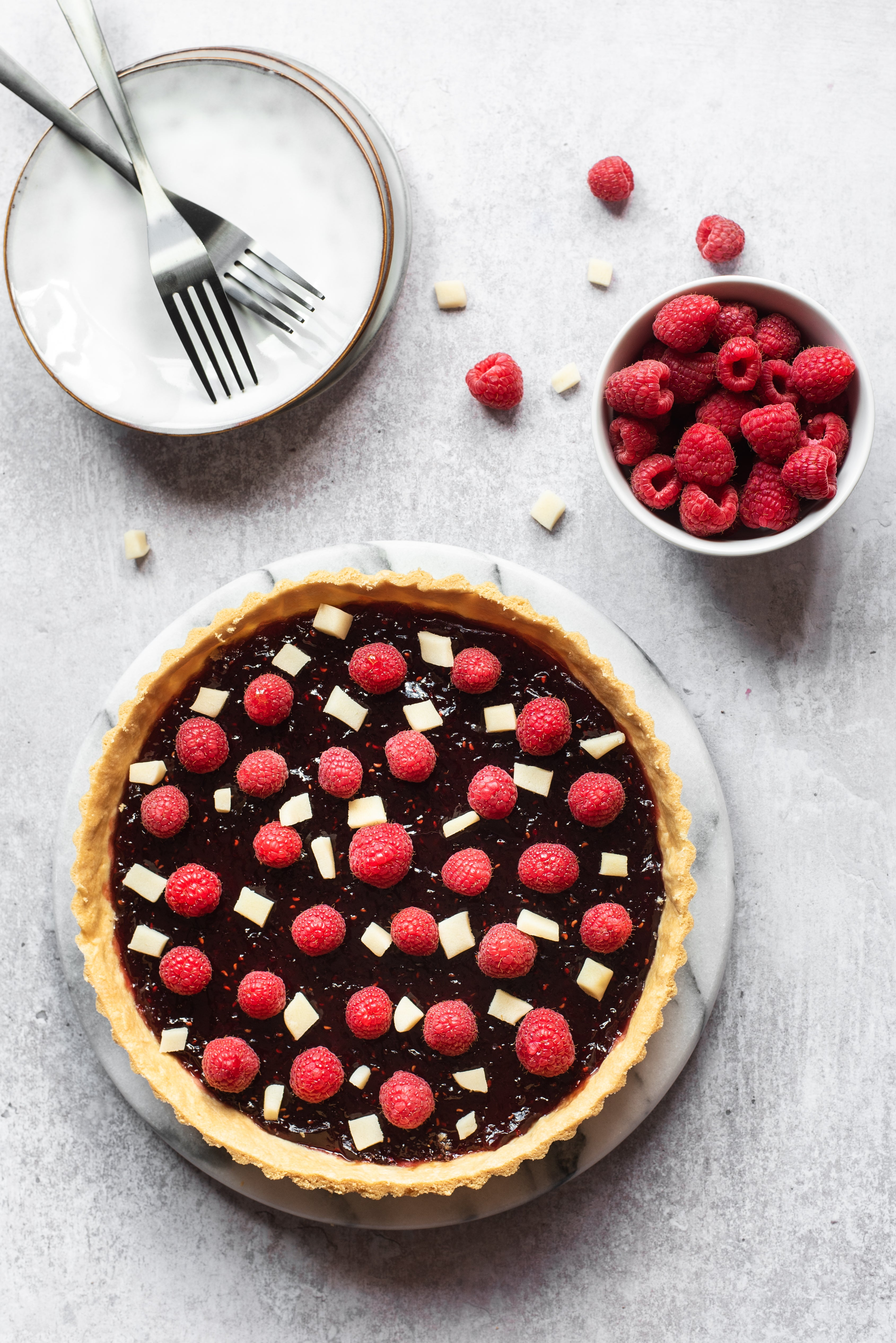 birds-eye view of a sweet tart topped with raspberries