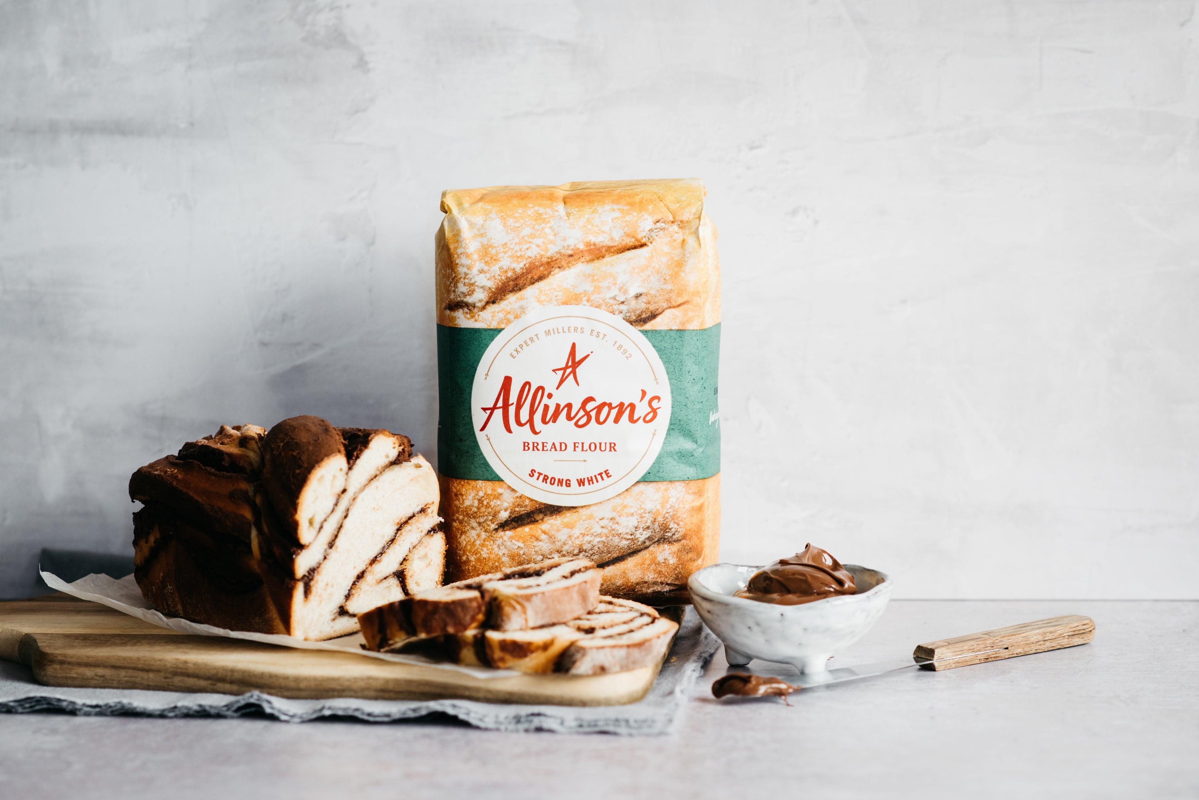 Sliced Chocolate Babka with Allinson's flour and a bowl of chocolate spread