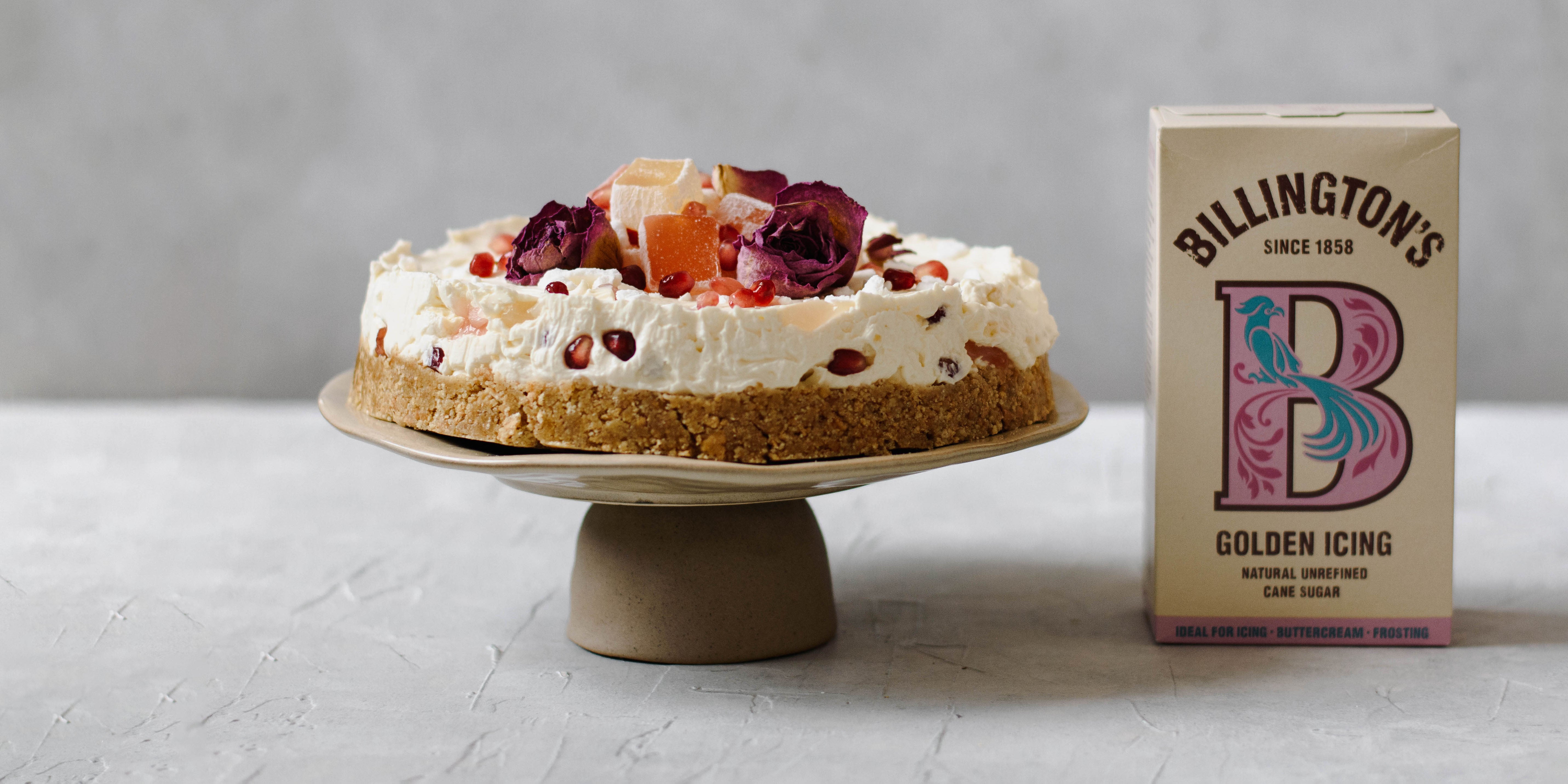 Turkish Delight Cheesecake on cake stand with sugar pack