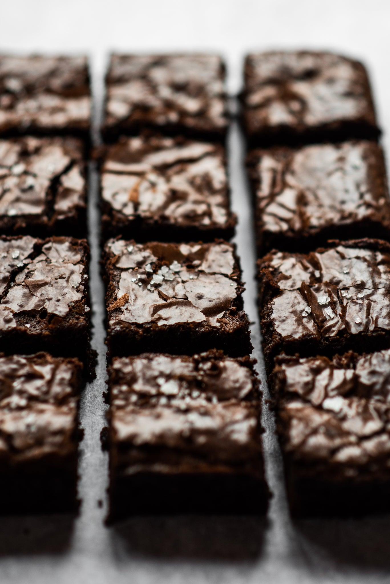 Close up of a gooey chocolate brownies sprinkled in sugar