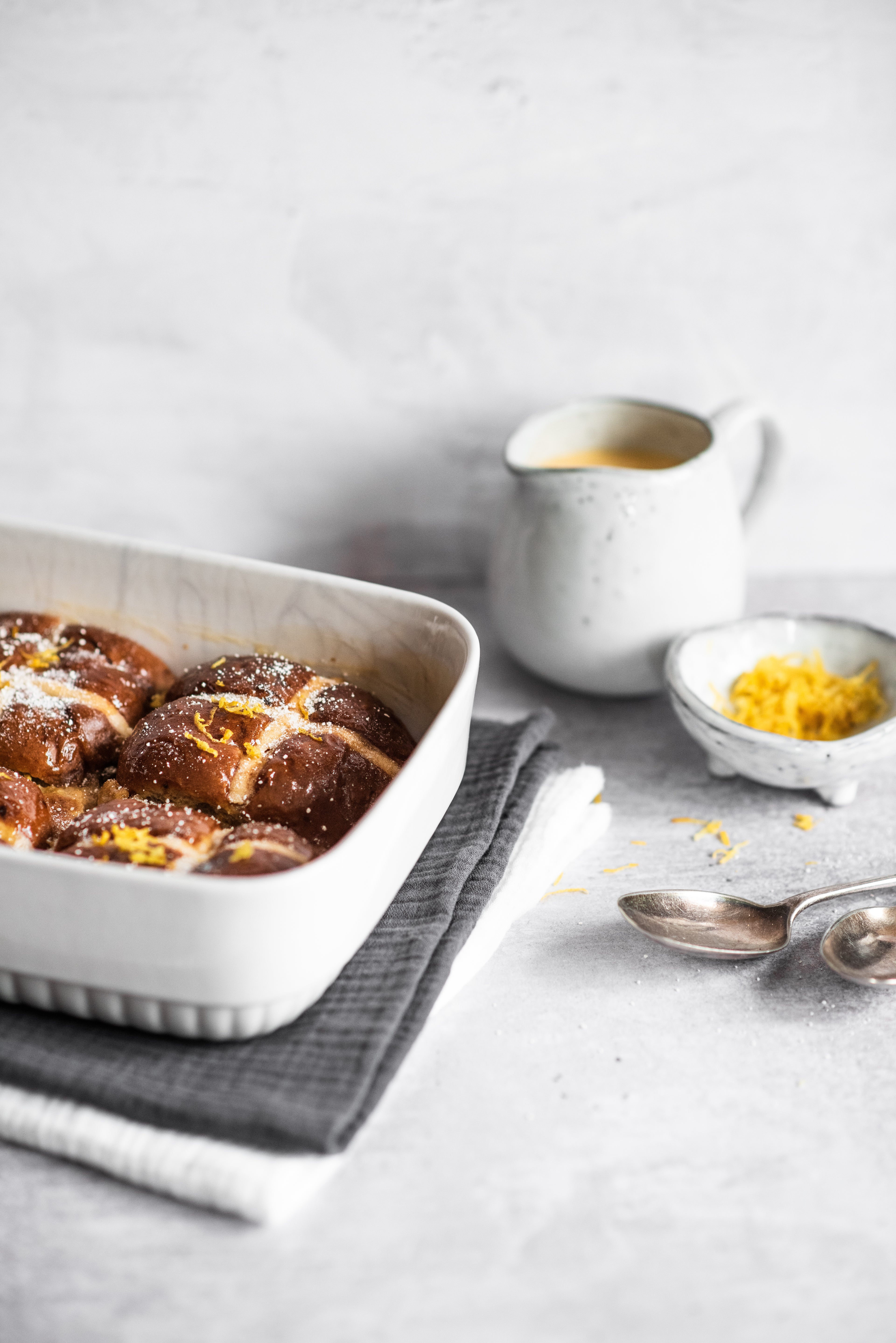 Four Hot Cross Bun Bread Butter Puddings in a tray
