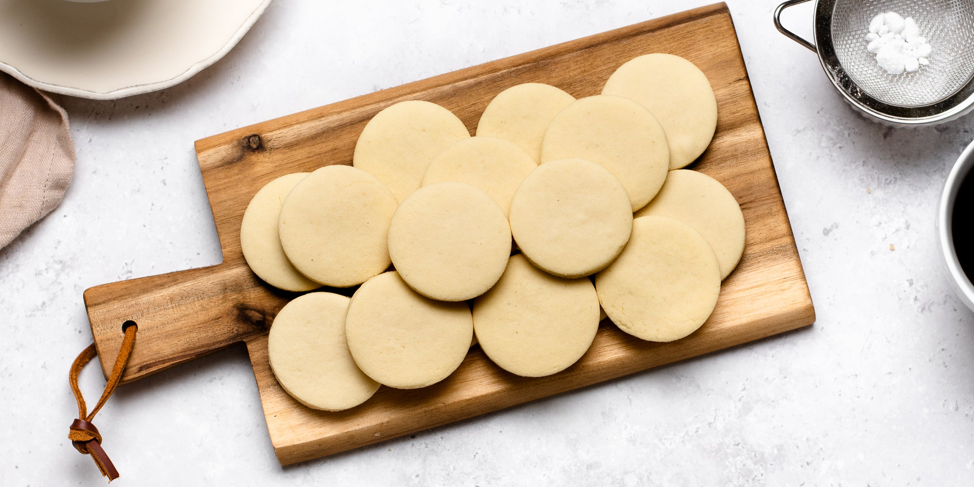 Top down view of vegan shortbread laid out on a chopping board