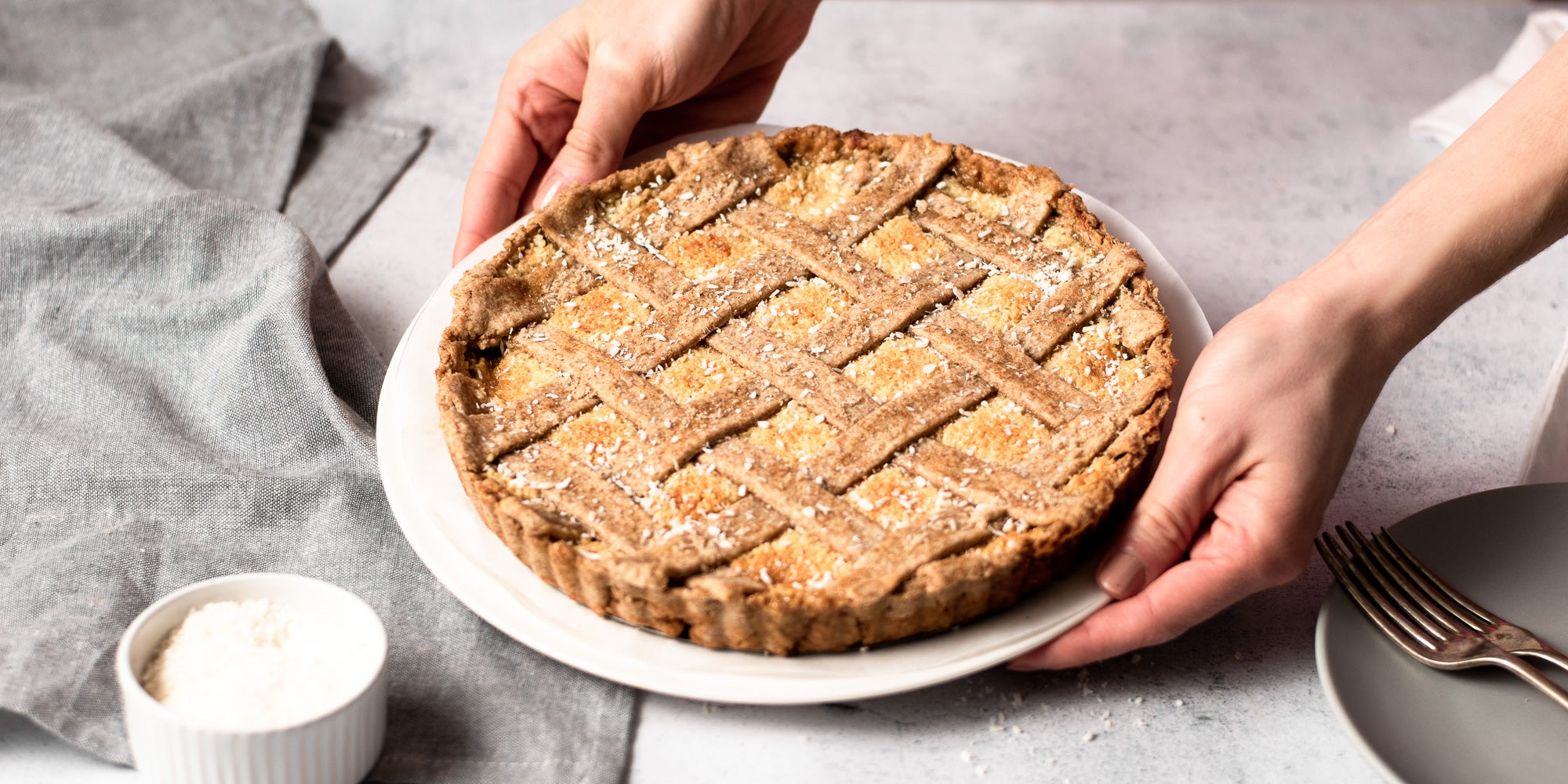 person holding coconut tart
