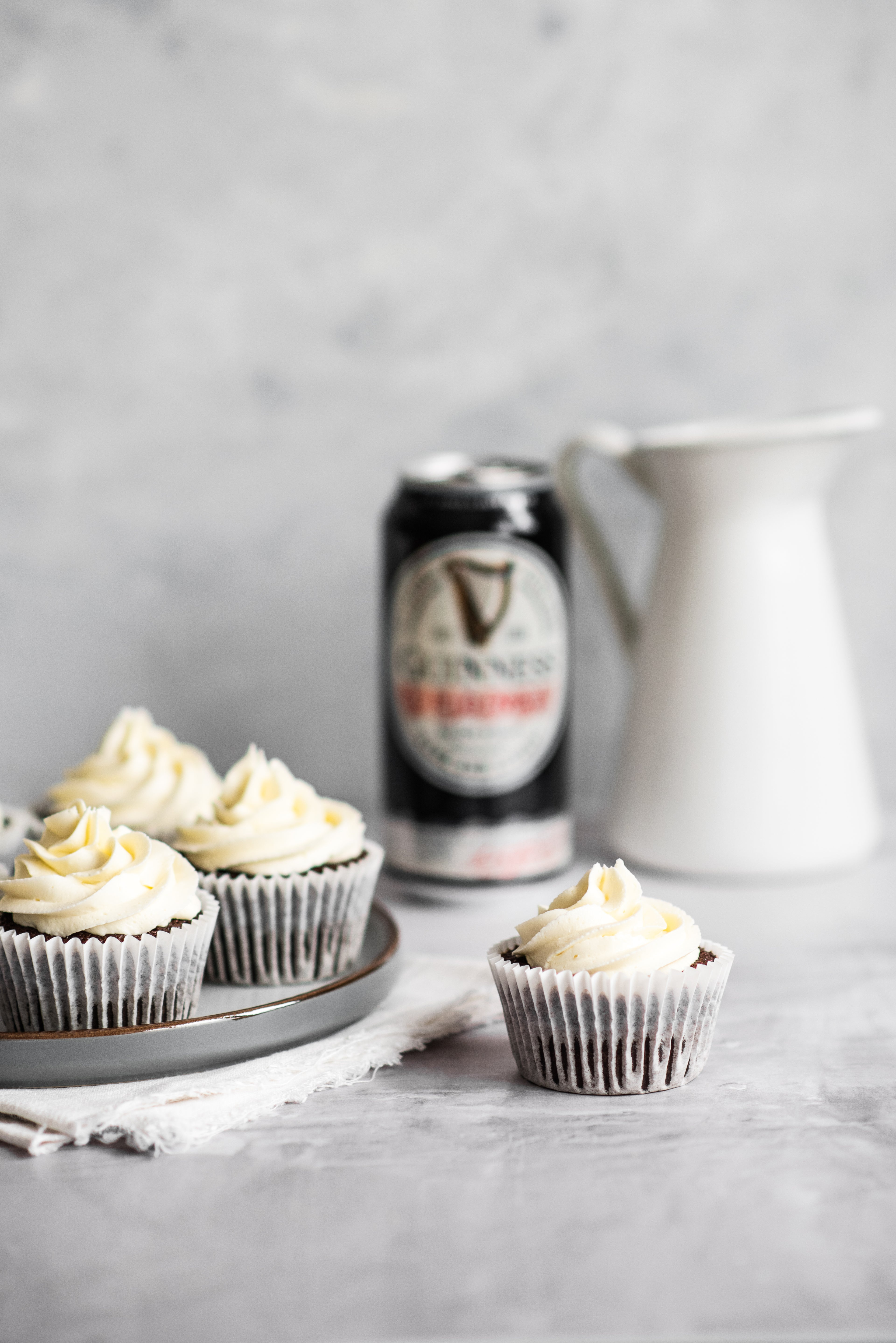 Cupcake centre of image with Guinness in the background
