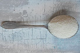 Golden caster sugar on a spoon