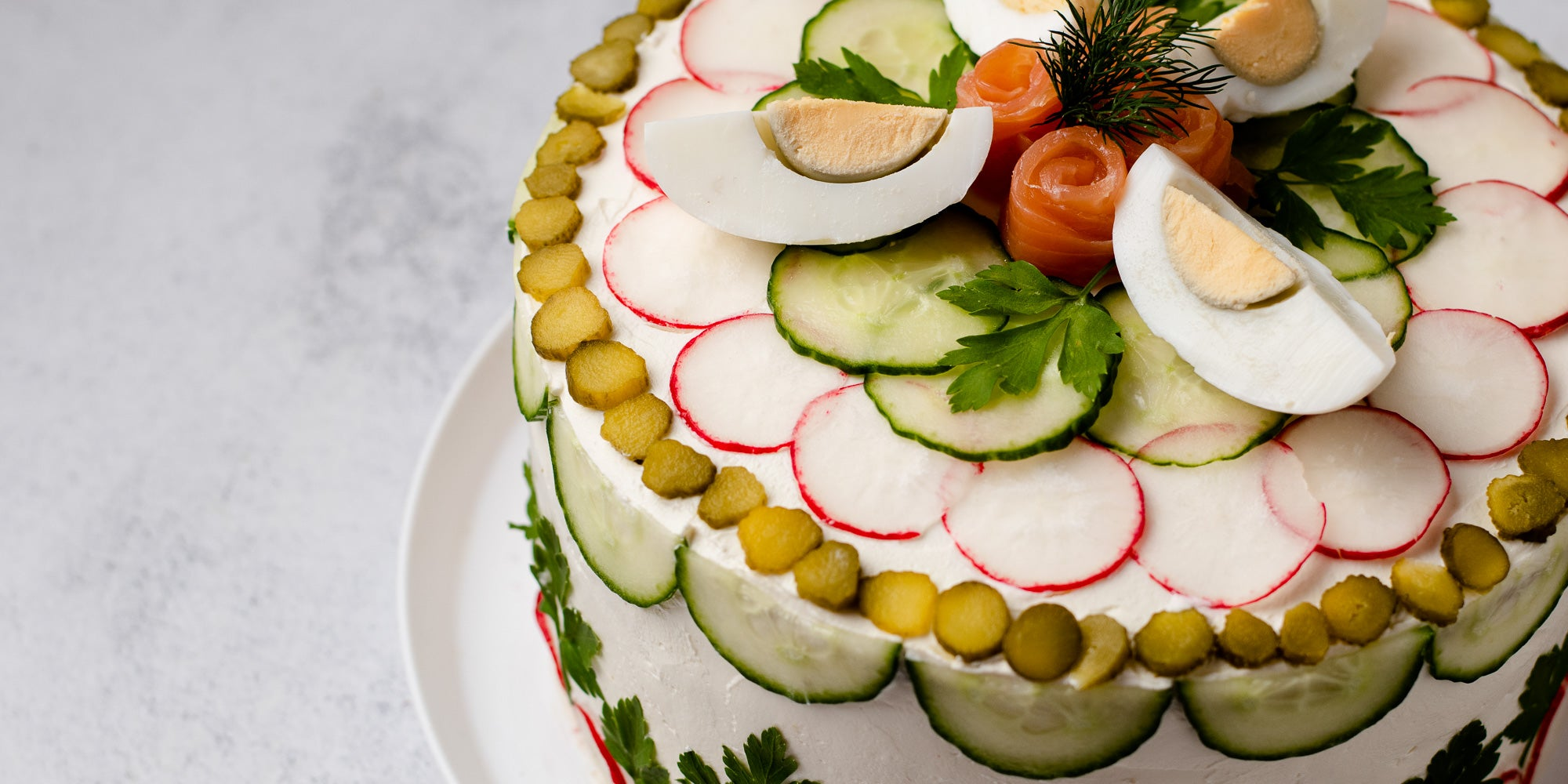Close up of sandwich cake on white plate