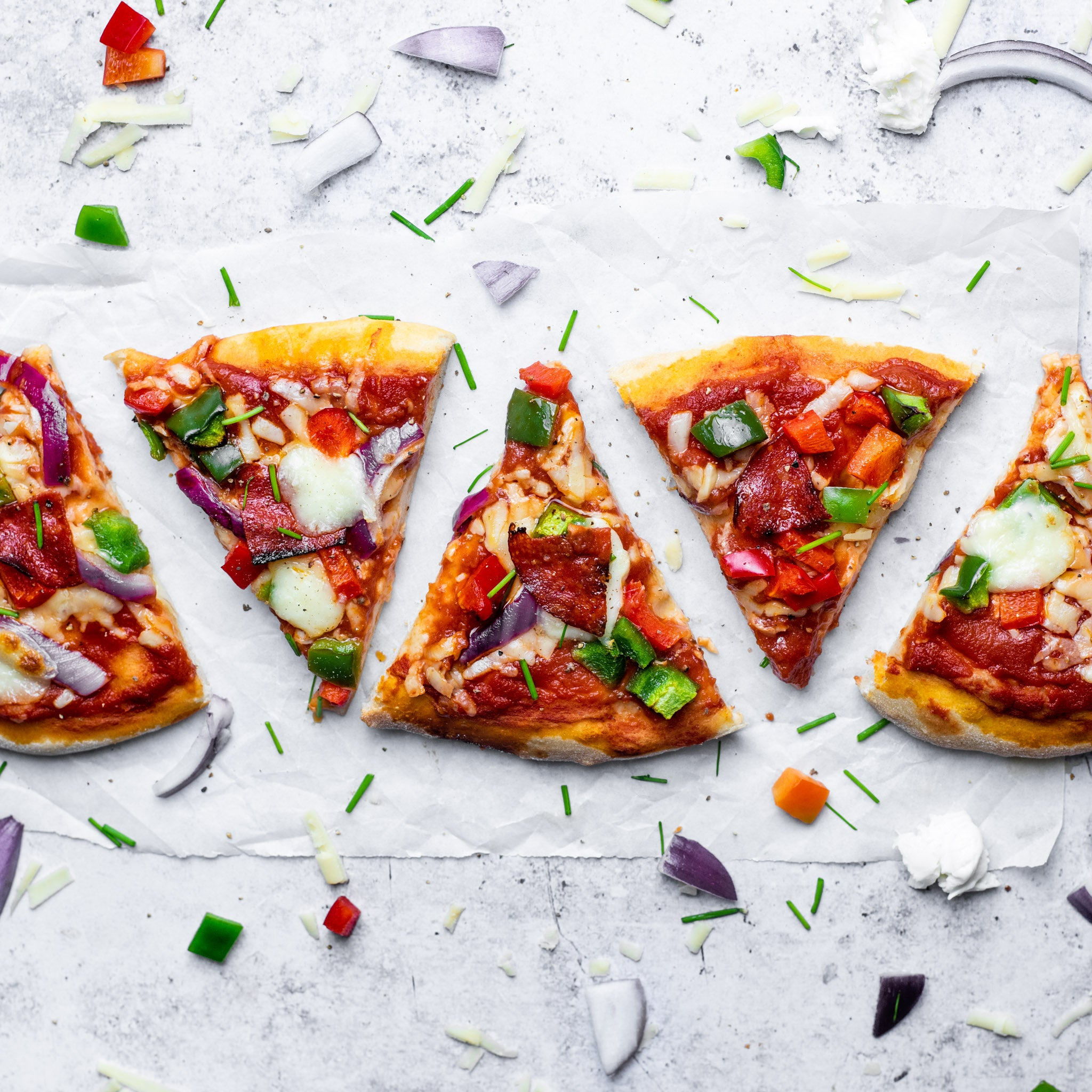 A line of single vegetarian pizza slices made from allinson's bread flour for pizza bases