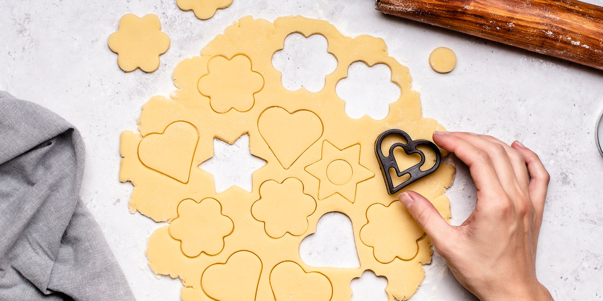 Basic Biscuit Dough rolled out with biscuit cutter and hand.