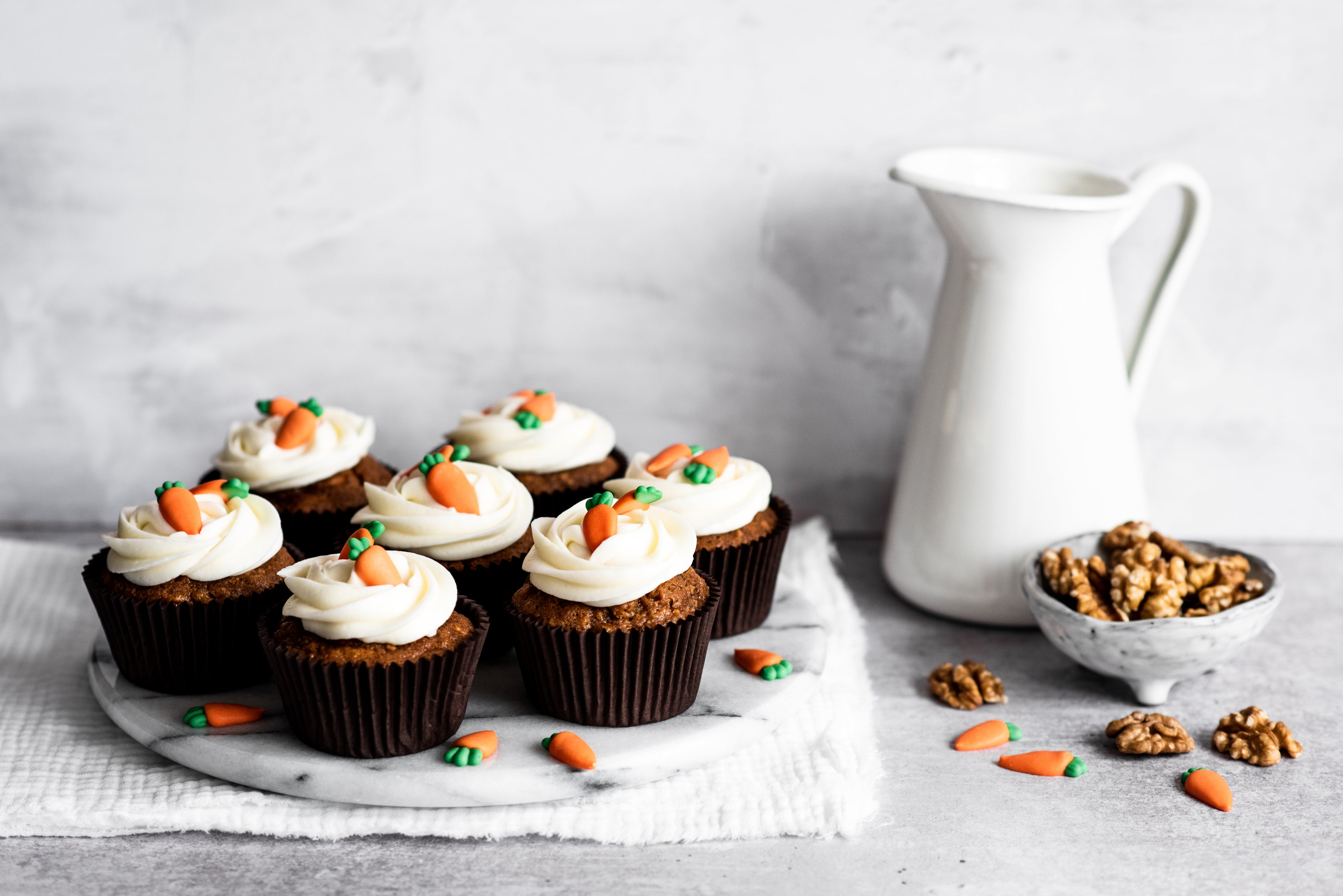 Carrot cake cupcakes with cream cheese icing and carrot decorations