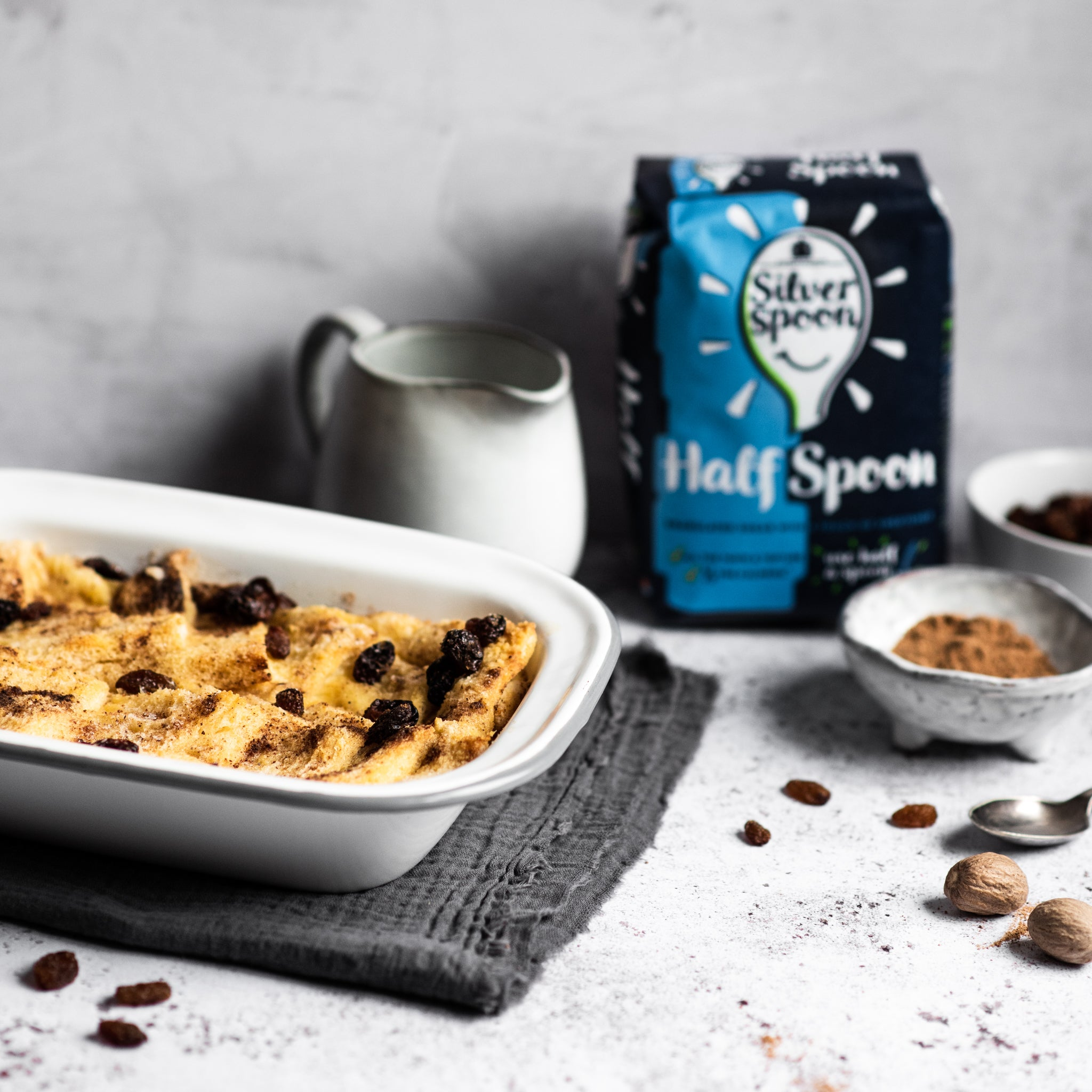 Bread and butter pudding in a tin with raisins