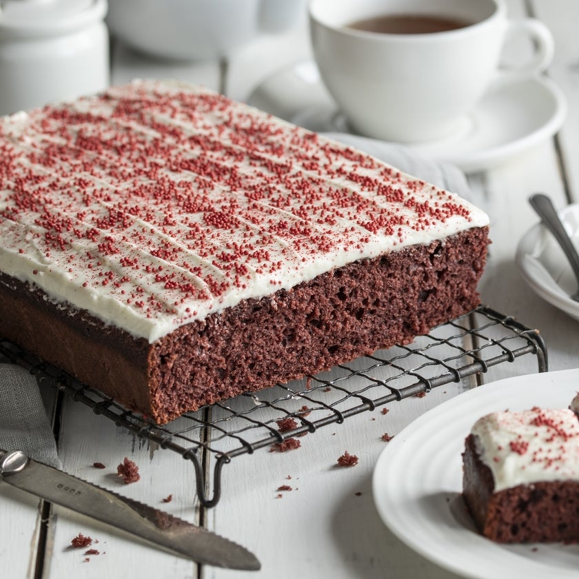 Red velvet traybake with cream cheese icing and red sprinkles