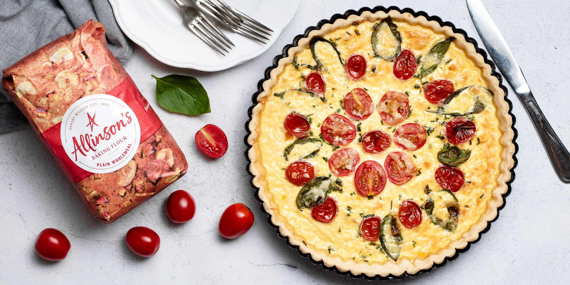 Cheese & Tomato Quiche with a bag of Allinson's Plain Wholemeal flour and chopped tomatoes