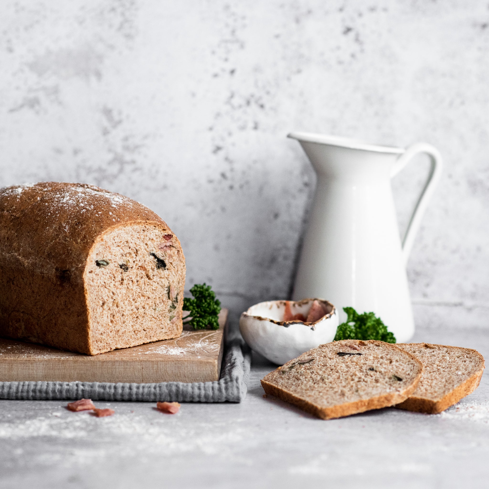 Loaf of bread on a chopping board with slice removed