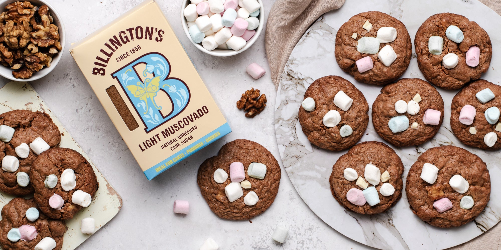Rocky Road Cookies lay next to a box of Billington's Light Muscovado sugar, and ramekins of walnuts and mini marshmallows