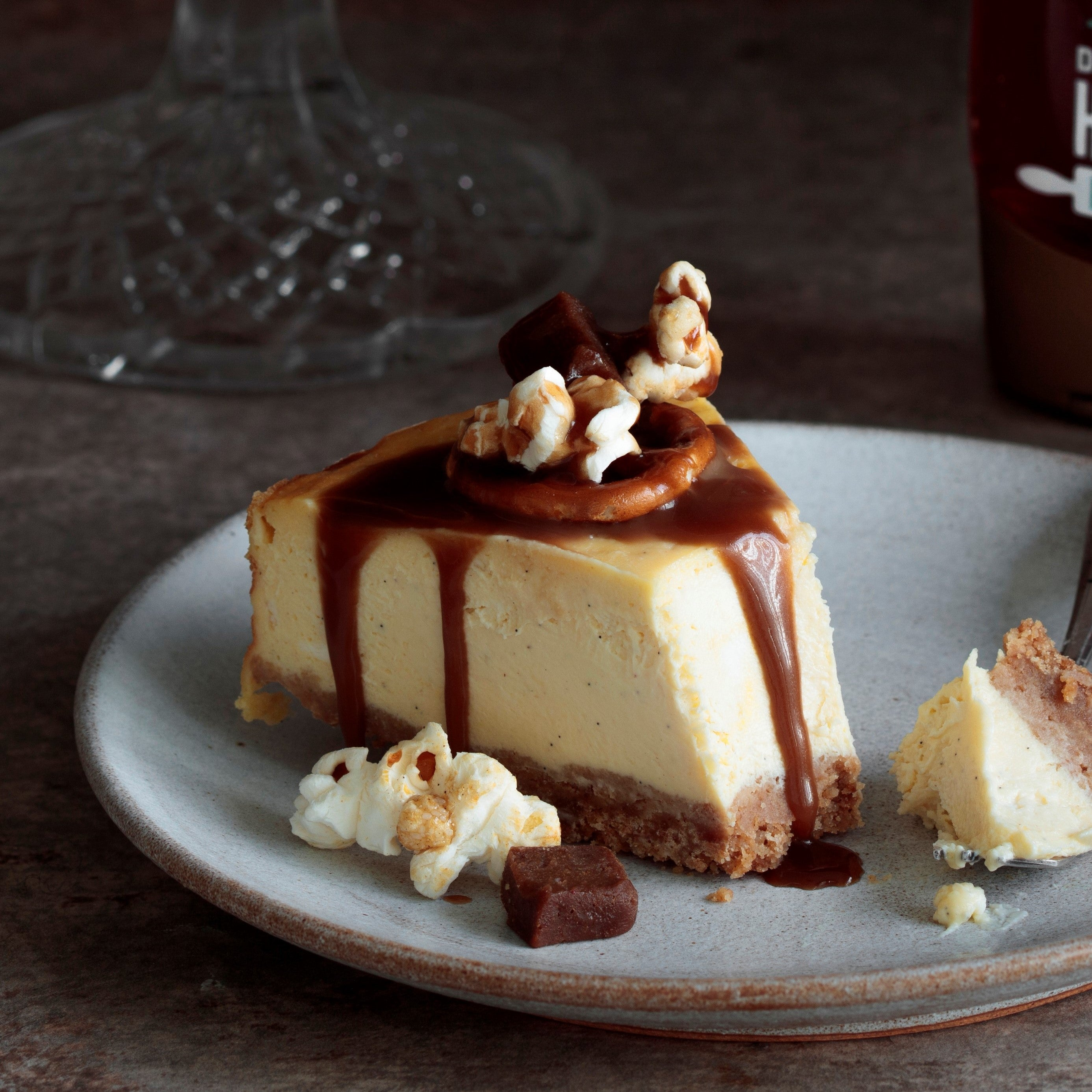Slice of cheesecake with salted caramel drizzle on plate