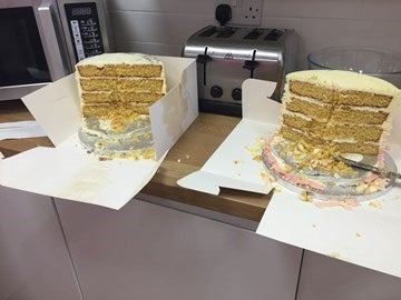 two cakes half eaten side by side