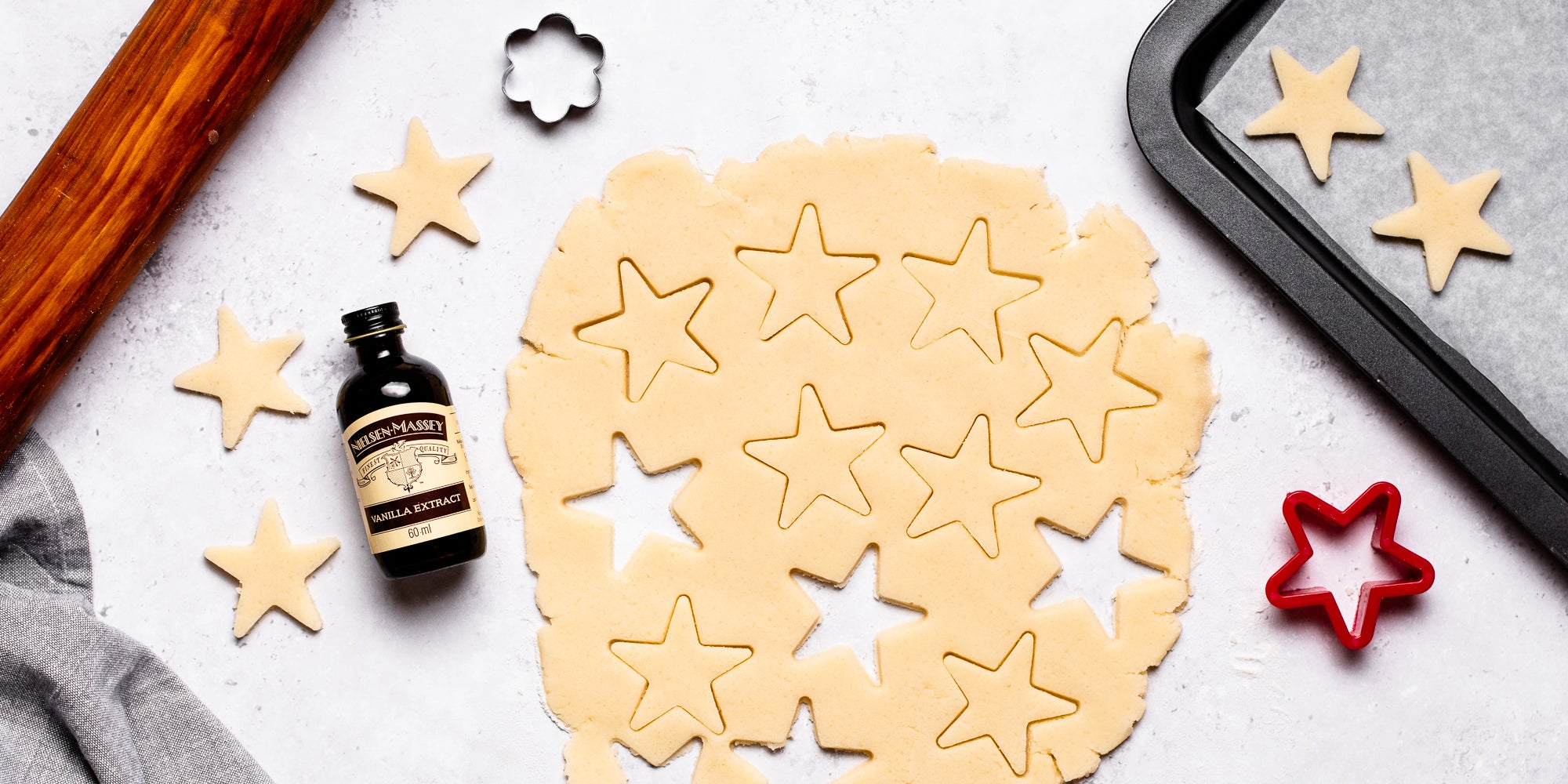 Top down view of cookie cutter stars in vegan biscuit dough