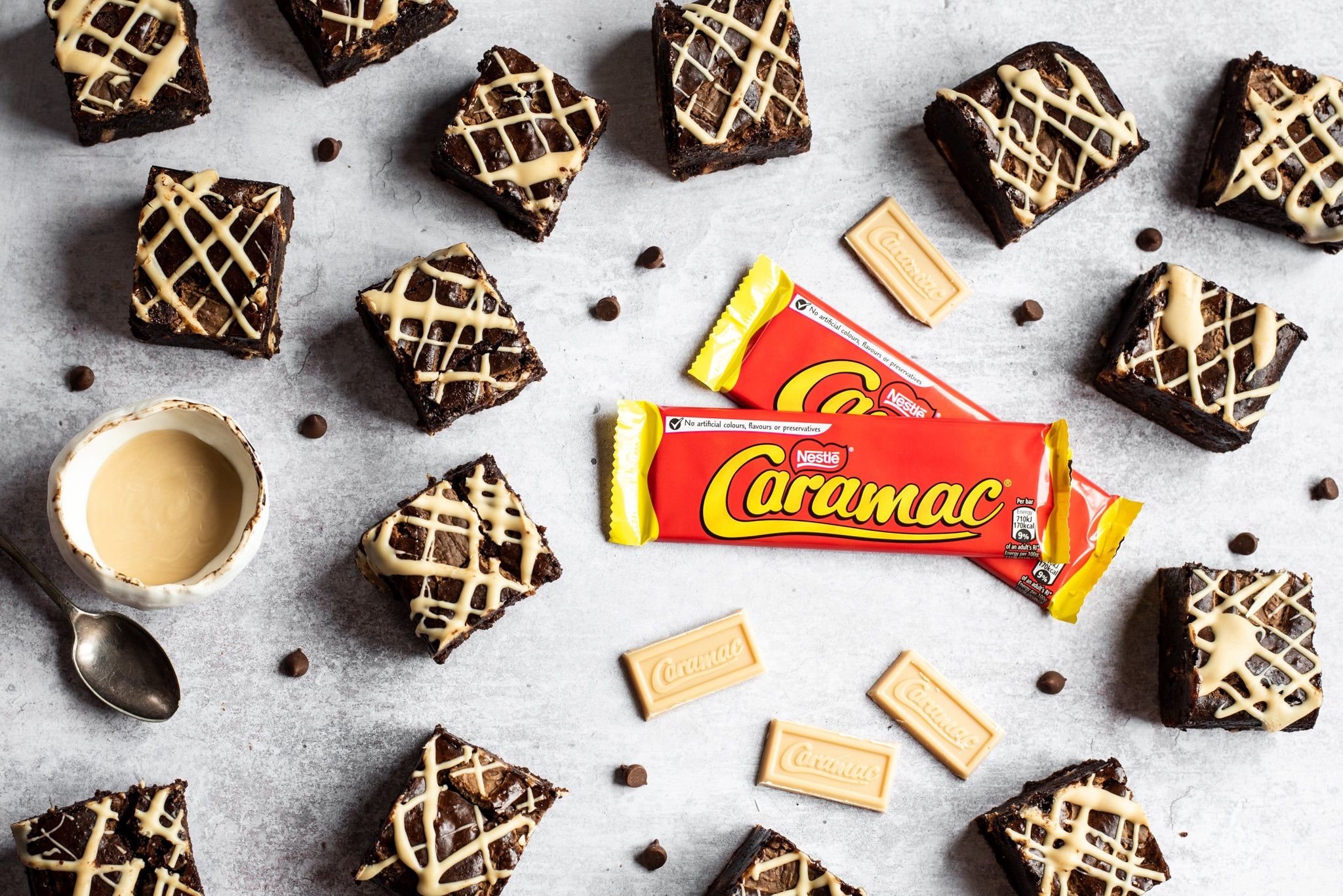 A top down view of a batch of chocolate brownies coated in caramac sauce